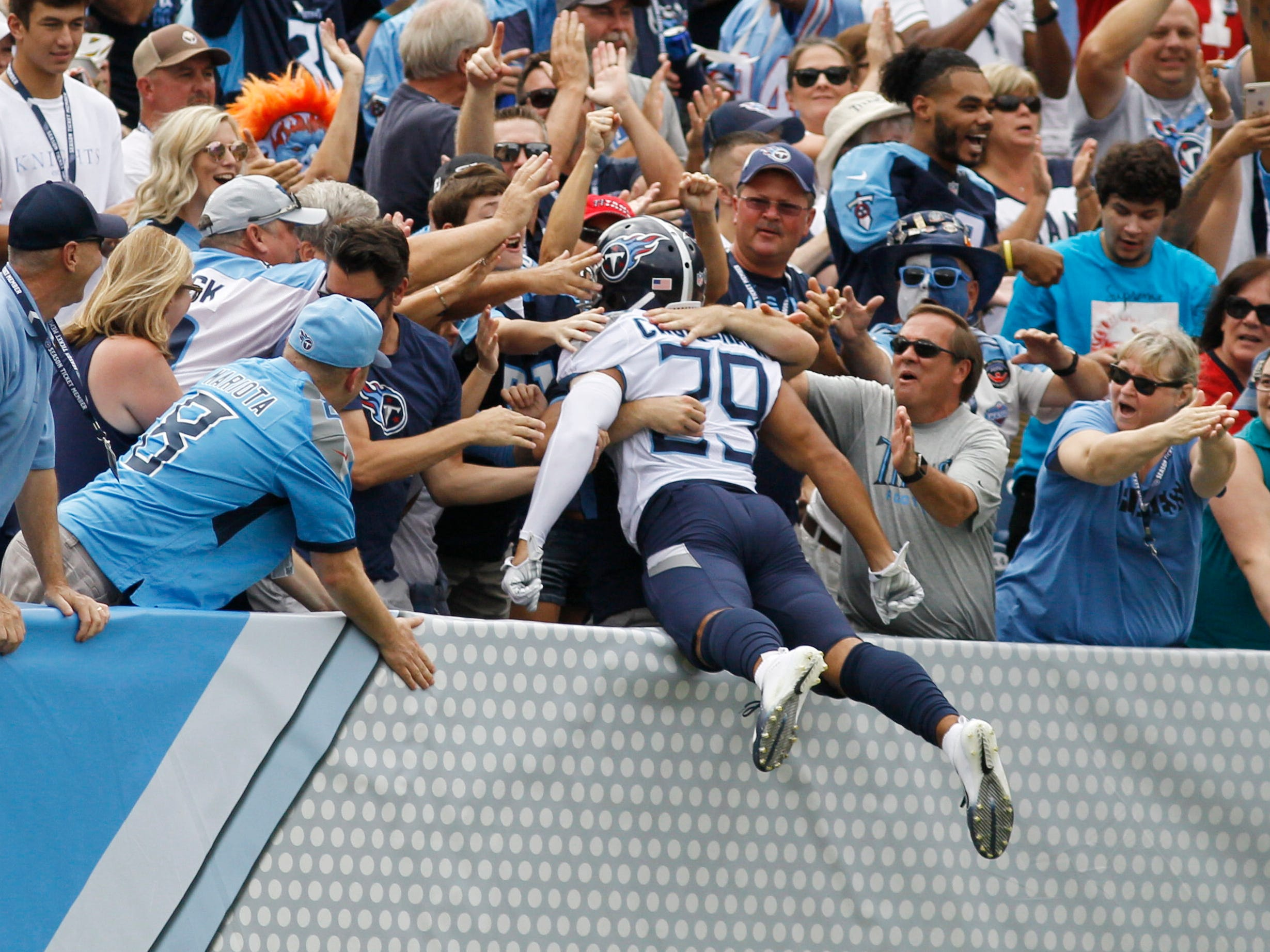 Titans cornerback Dane Cruikshank (29) celebrates his touchdown with fans at Nissan Stadium Sunday, Sept. 16, 2018, in Nashville, Tenn.
