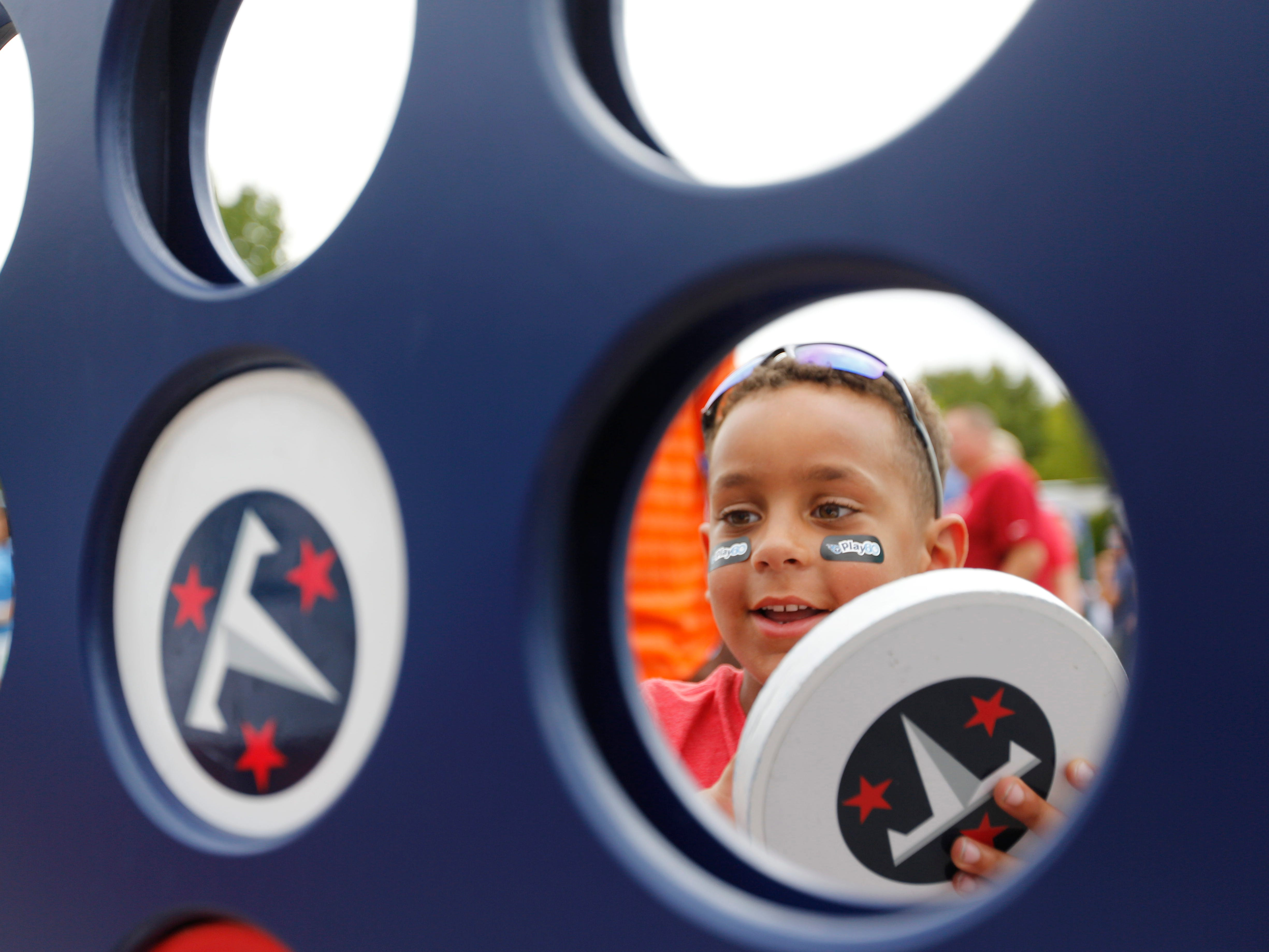 Tavian Alexander, 5, of Smyrna, plays a game of Connect Four before the game at Nissan Stadium Sunday, Sept. 16, 2018, in Nashville, Tenn.