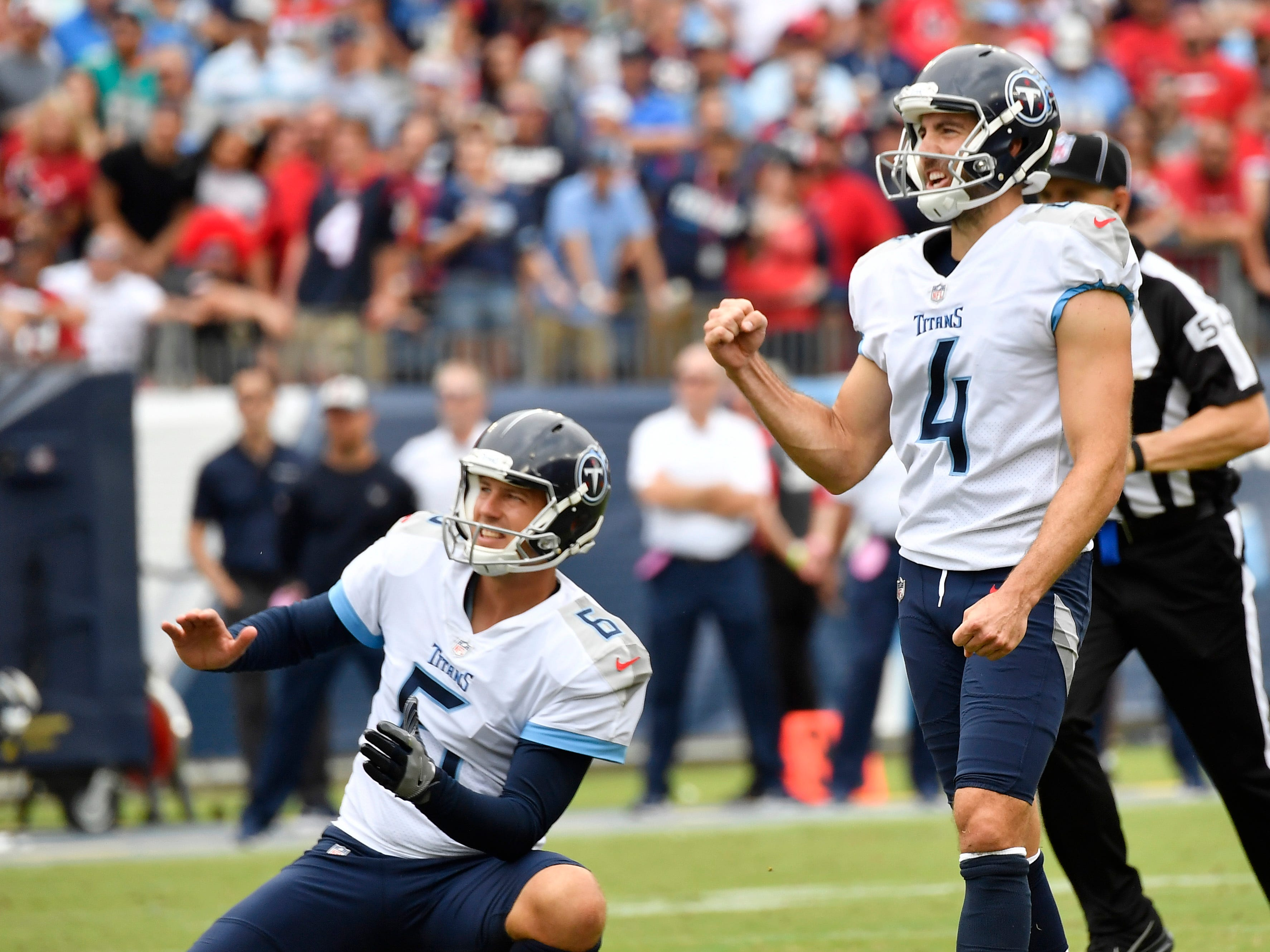 Titans place kicker Ryan Succop (4) and punter Brett Kern (6) celebrate Succop's field goal that tied the game in the second half at Nissan Stadium Sunday, Sept. 16, 2018, in Nashville, Tenn.