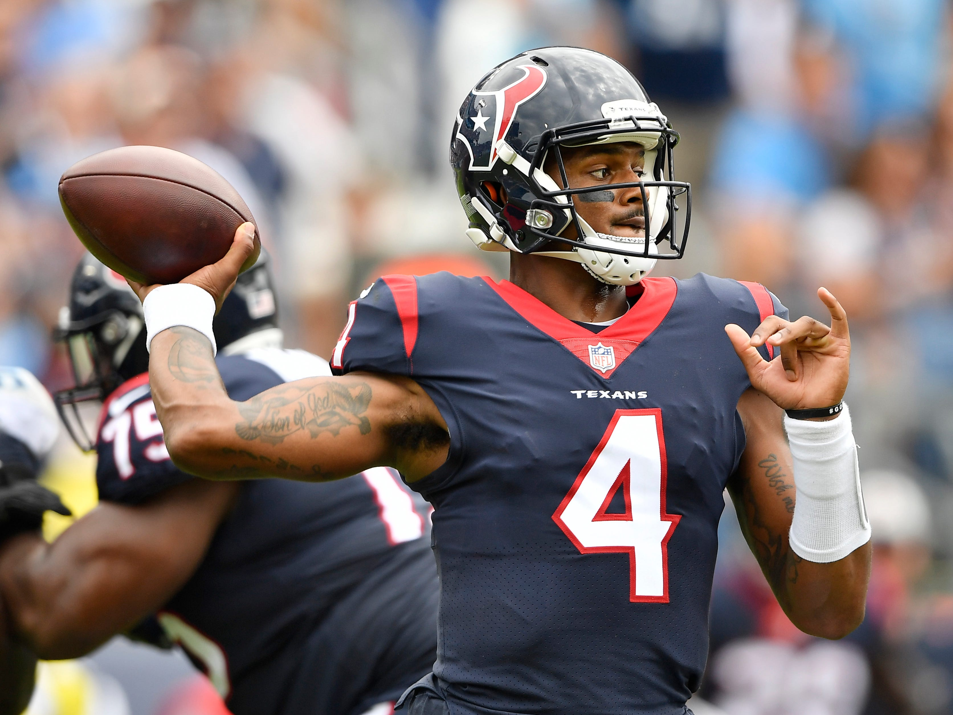 Texans quarterback Deshaun Watson (4) looks to pass in the first half at Nissan Stadium Sunday, Sept. 16, 2018, in Nashville, Tenn.