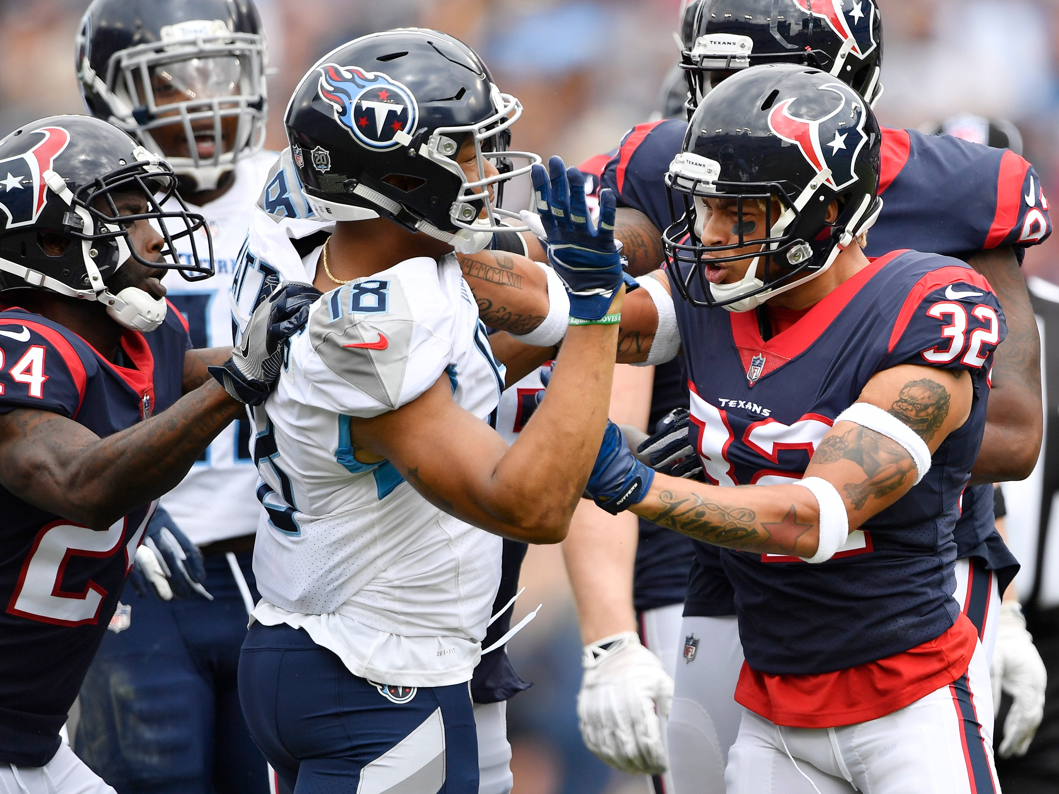 Titans wide receiver Rishard Matthews (18) and Texans safety Tyrann Mathieu (32) get into a scuffle in the first quarter at Nissan Stadium Sunday, Sept. 16, 2018, in Nashville, Tenn.