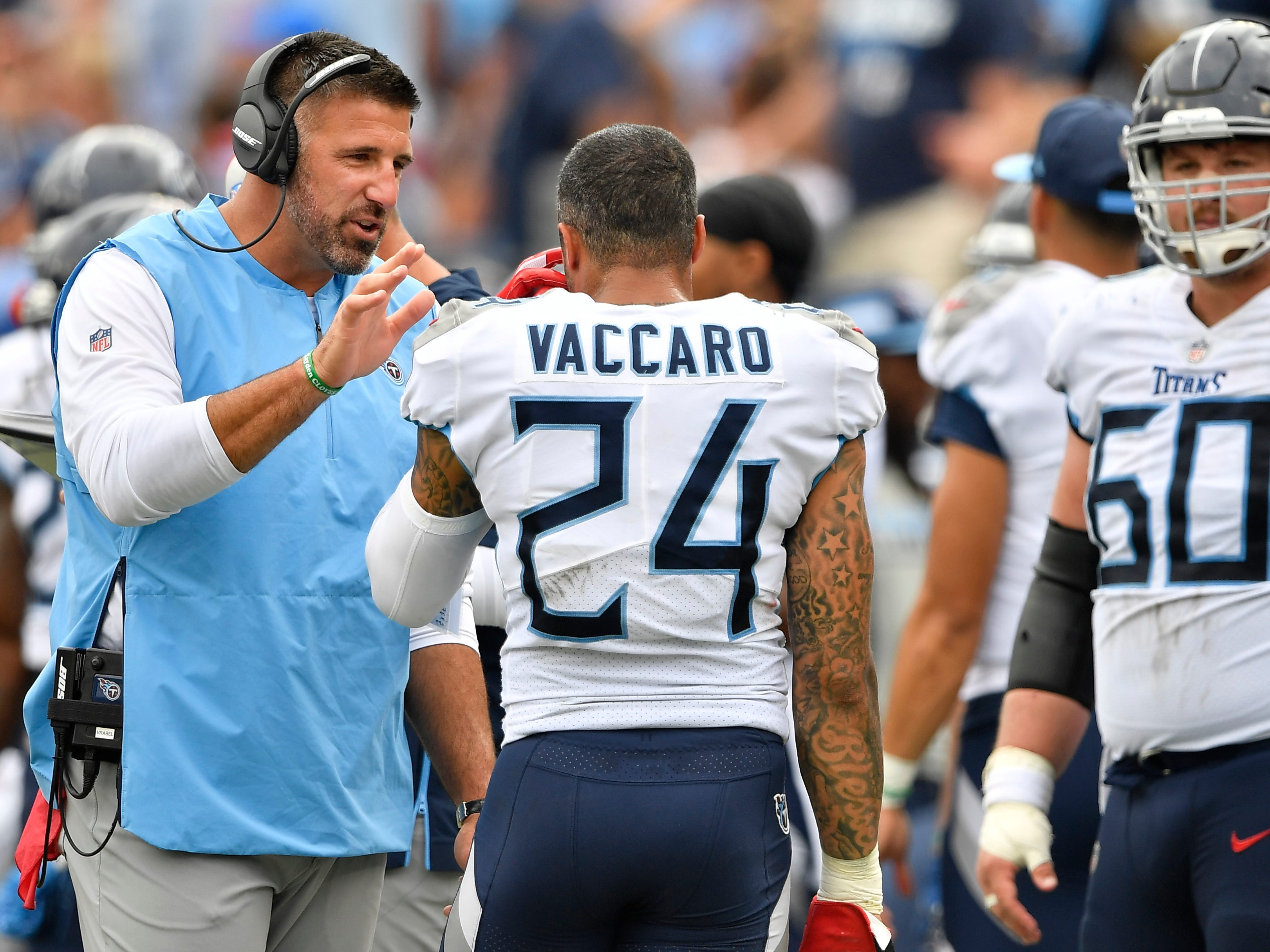 Titans head coach Mike Vrabel talks to safety Kenny Vaccaro (24) in the third quarter at Nissan Stadium Sunday, Sept. 16, 2018, in Nashville, Tenn.