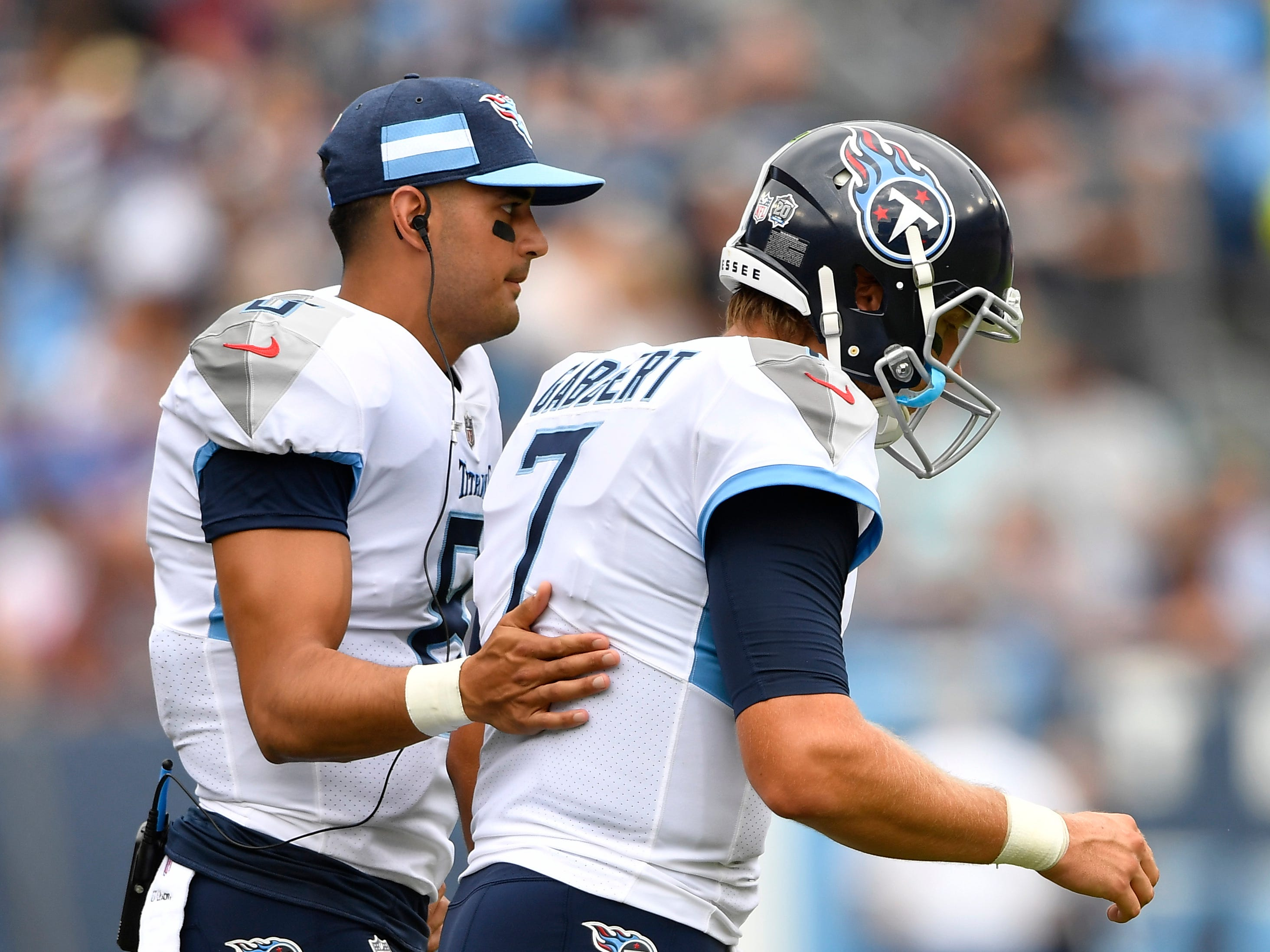 Titans quarterback Marcus Mariota (8) pats quarterback Blaine Gabbert (7) on the back as he heads onto the field in the first quarter at Nissan Stadium Sunday, Sept. 16, 2018, in Nashville, Tenn.