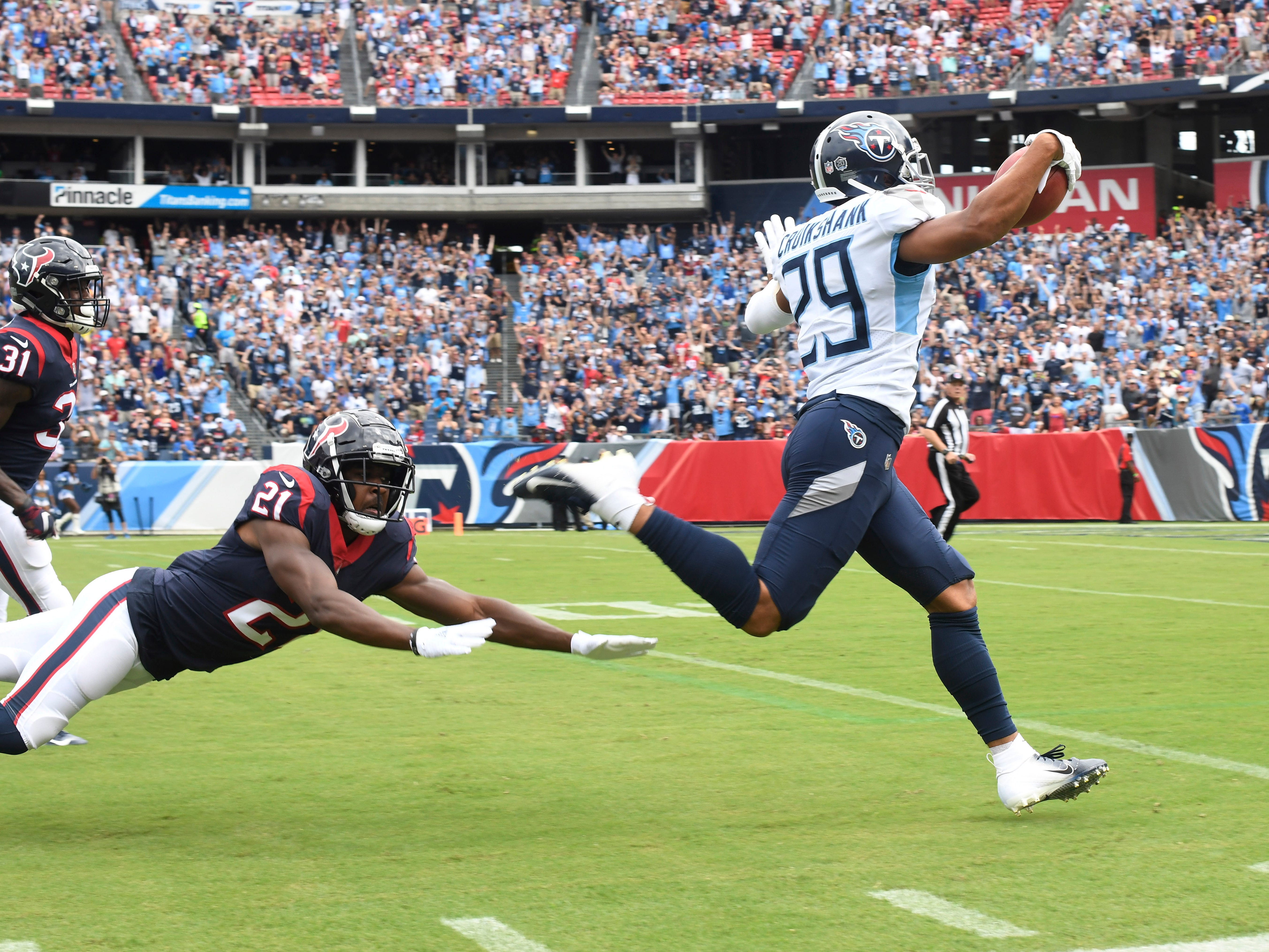 Texans running back Tyler Ervin (21) dives but can't stop a touchdown by Titans cornerback Dane Cruikshank (29) in the first quarter at Nissan Stadium Sunday, Sept. 16, 2018, in Nashville, Tenn.