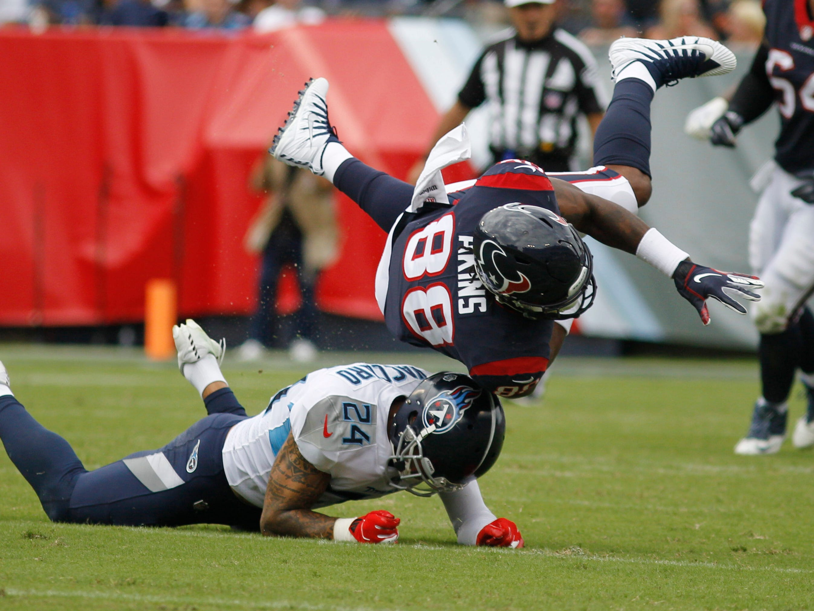 Texans tight end Jordan Akins (88) goes flying after being hit by Titans safety Kenny Vaccaro (24) in the second quarter at Nissan Stadium Sunday, Sept. 16, 2018, in Nashville, Tenn.