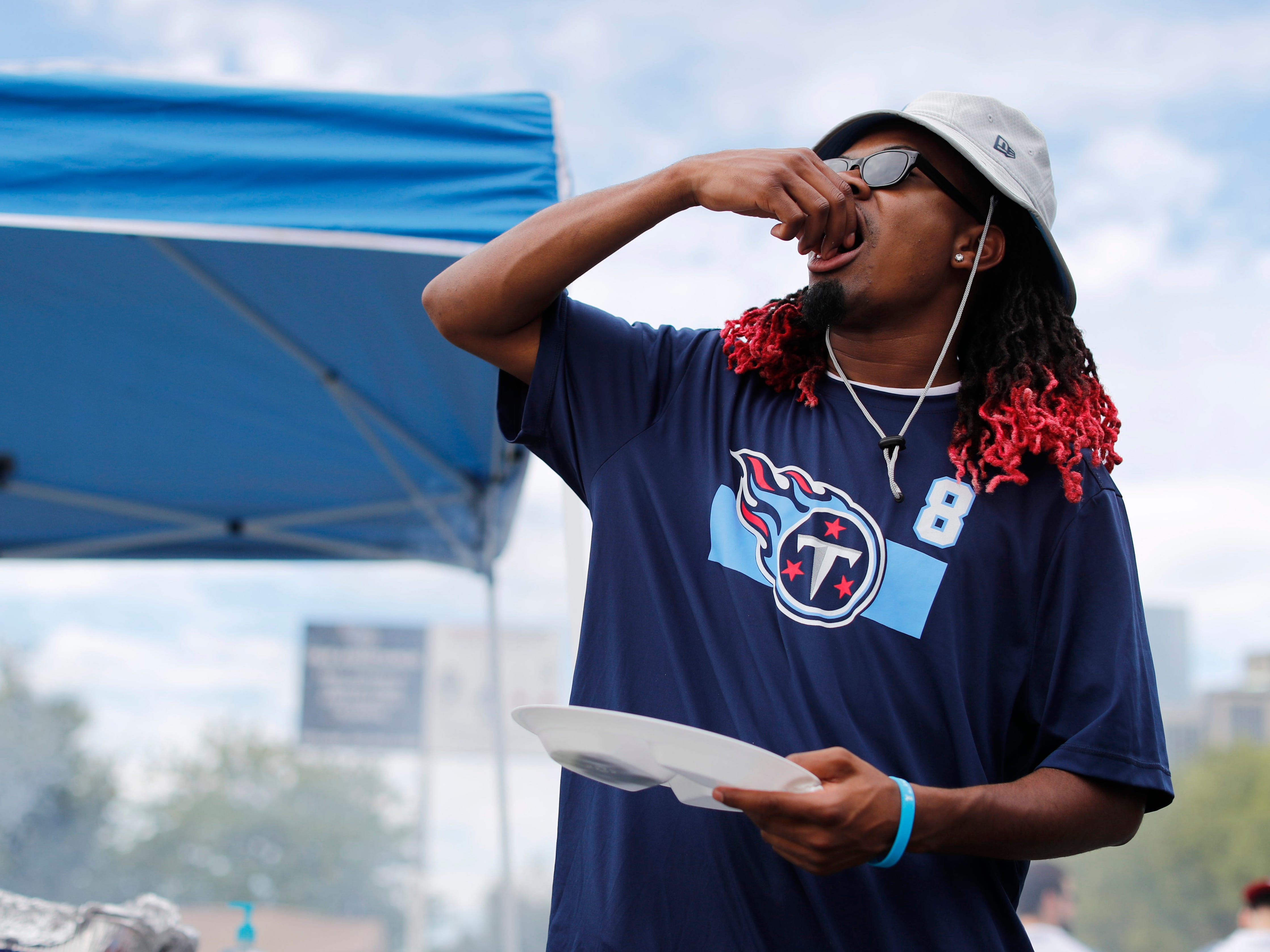 A Titans fan tailgates before the game against the Texans at Nissan Stadium Sunday, Sept. 16, 2018, in Nashville, Tenn.