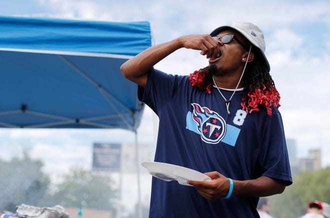 A Titans fan tailgates before the game Sunday against the Texans at Nissan Stadium.