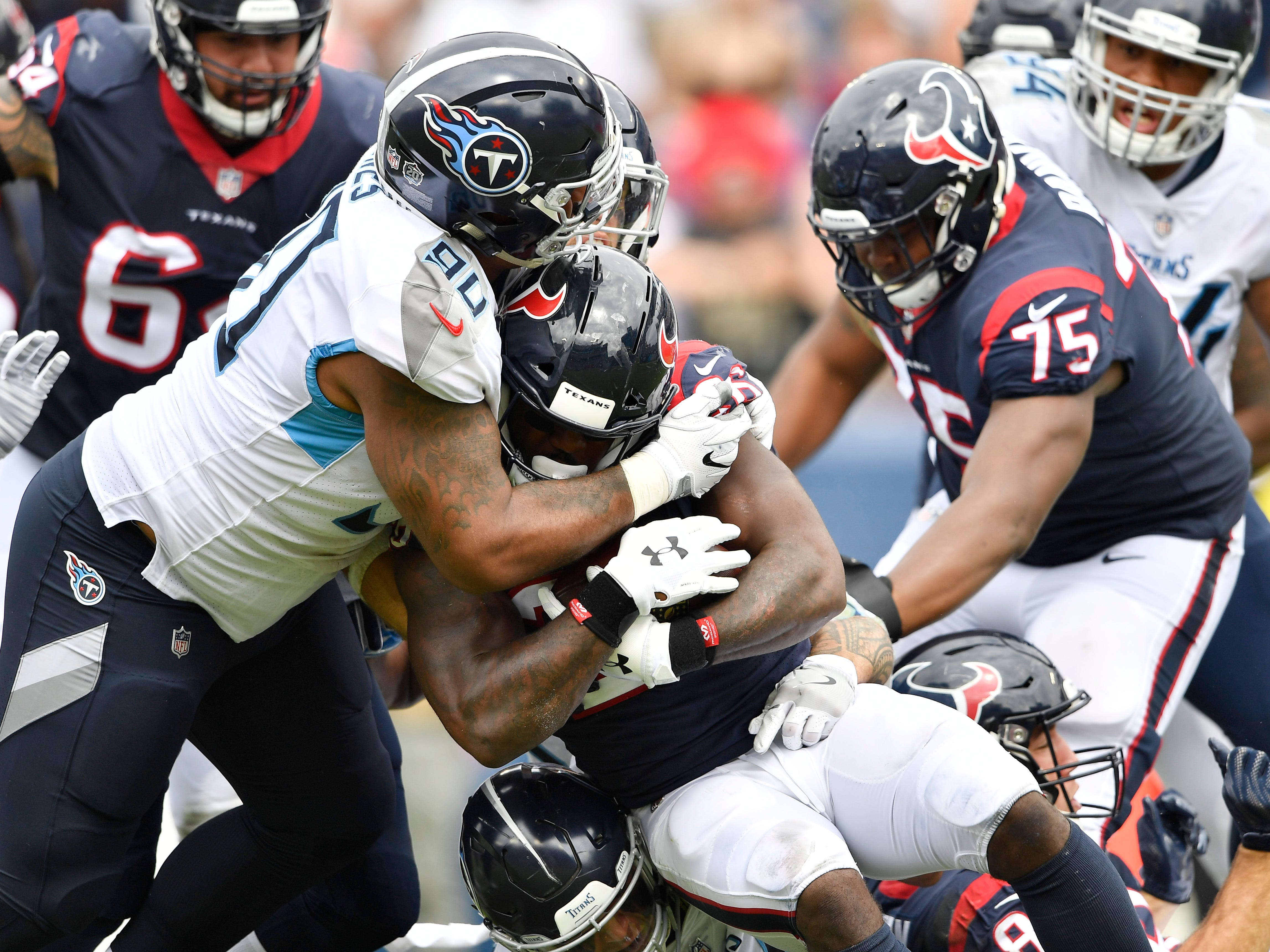 Titans defensive tackle DaQuan Jones (90) stops Texans safety Justin Reid (20) in the second half at Nissan Stadium Sunday, Sept. 16, 2018, in Nashville, Tenn.