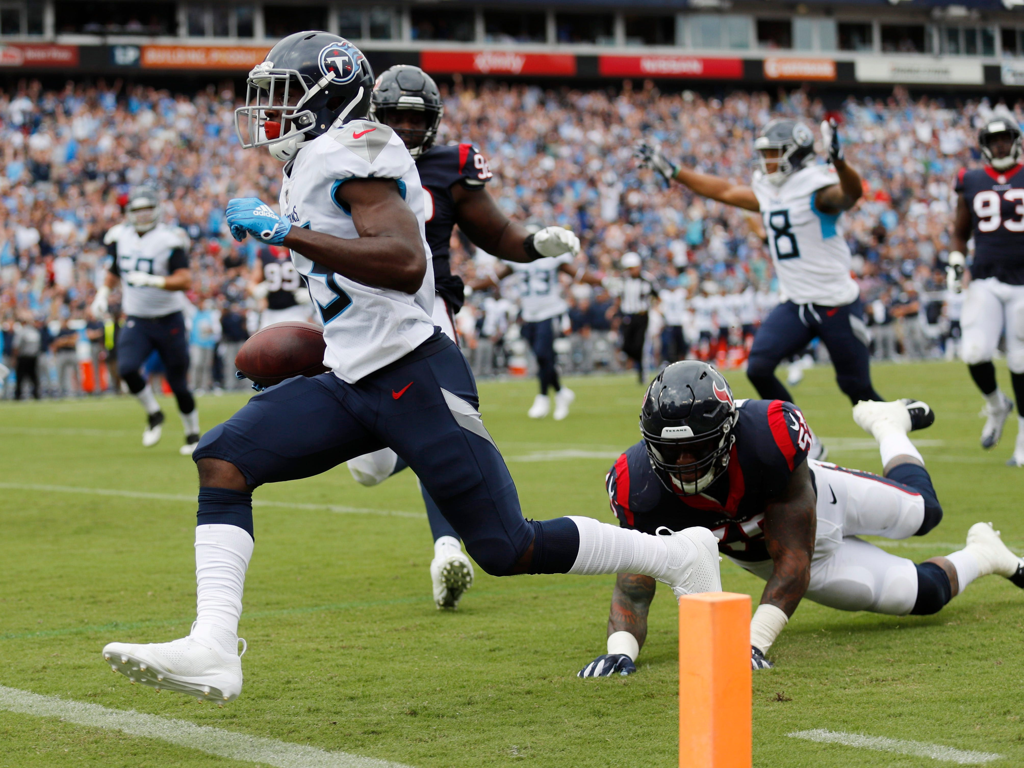 Titans wide receiver Taywan Taylor (13) scores the team's second touchdown in the first half at Nissan Stadium Sunday, Sept. 16, 2018, in Nashville, Tenn.