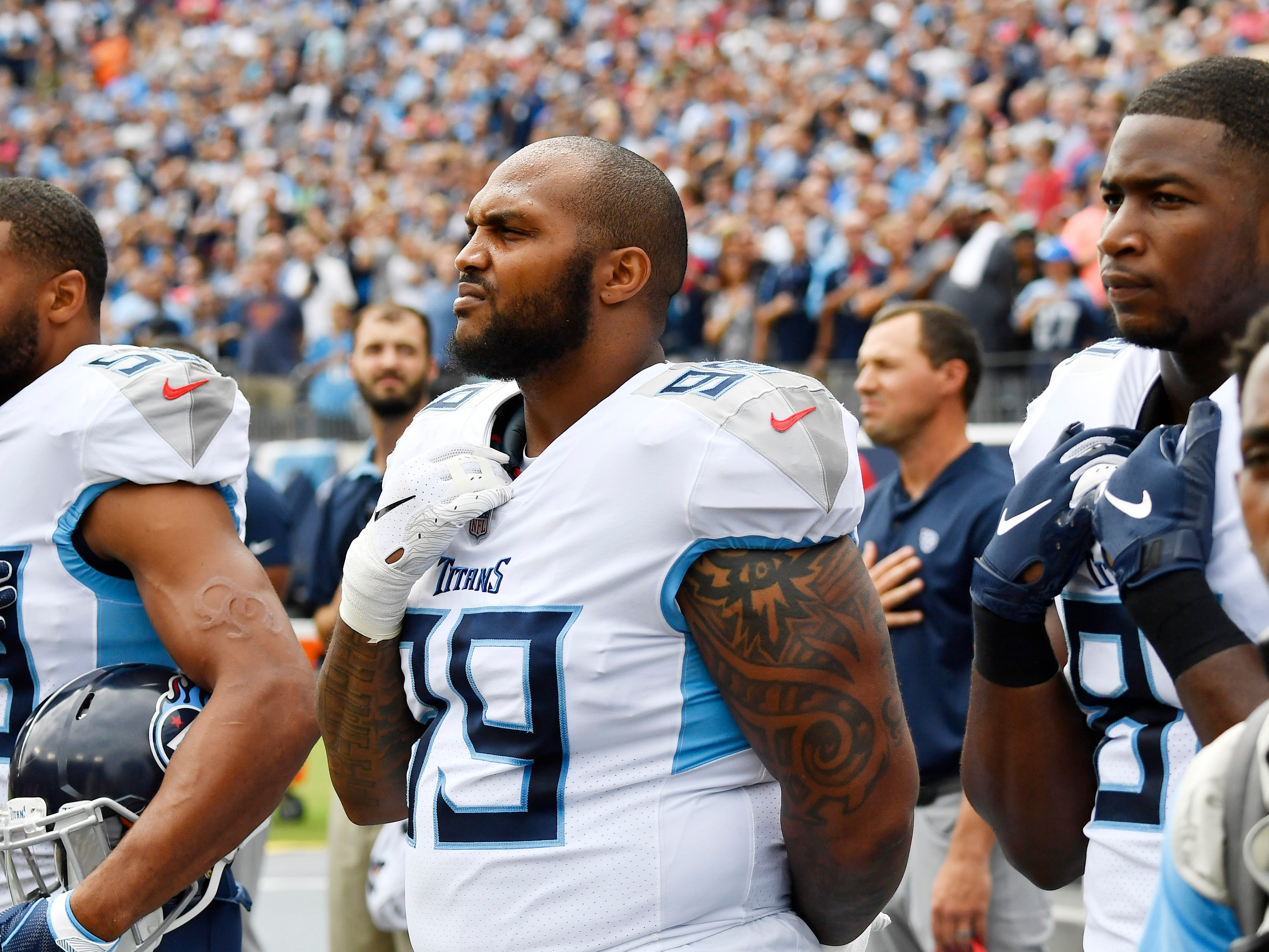 The Titans stand for the National Anthem at Nissan Stadium Sunday, Sept. 16, 2018, in Nashville, Tenn.