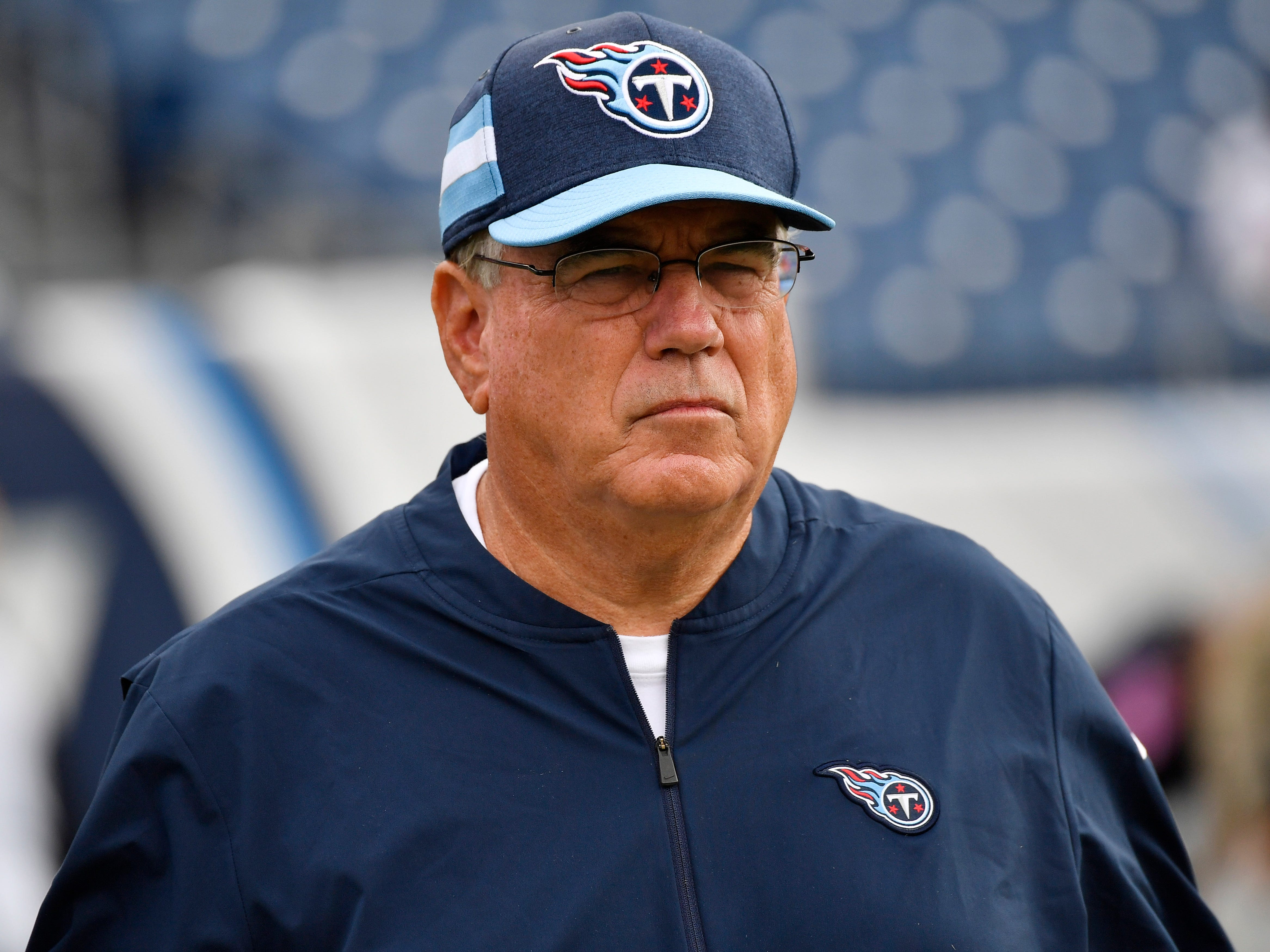 Defensive coordinator Dean Pees watches the Titans warm up before the game against the Texans at Nissan Stadium Sunday, Sept. 16, 2018, in Nashville, Tenn.