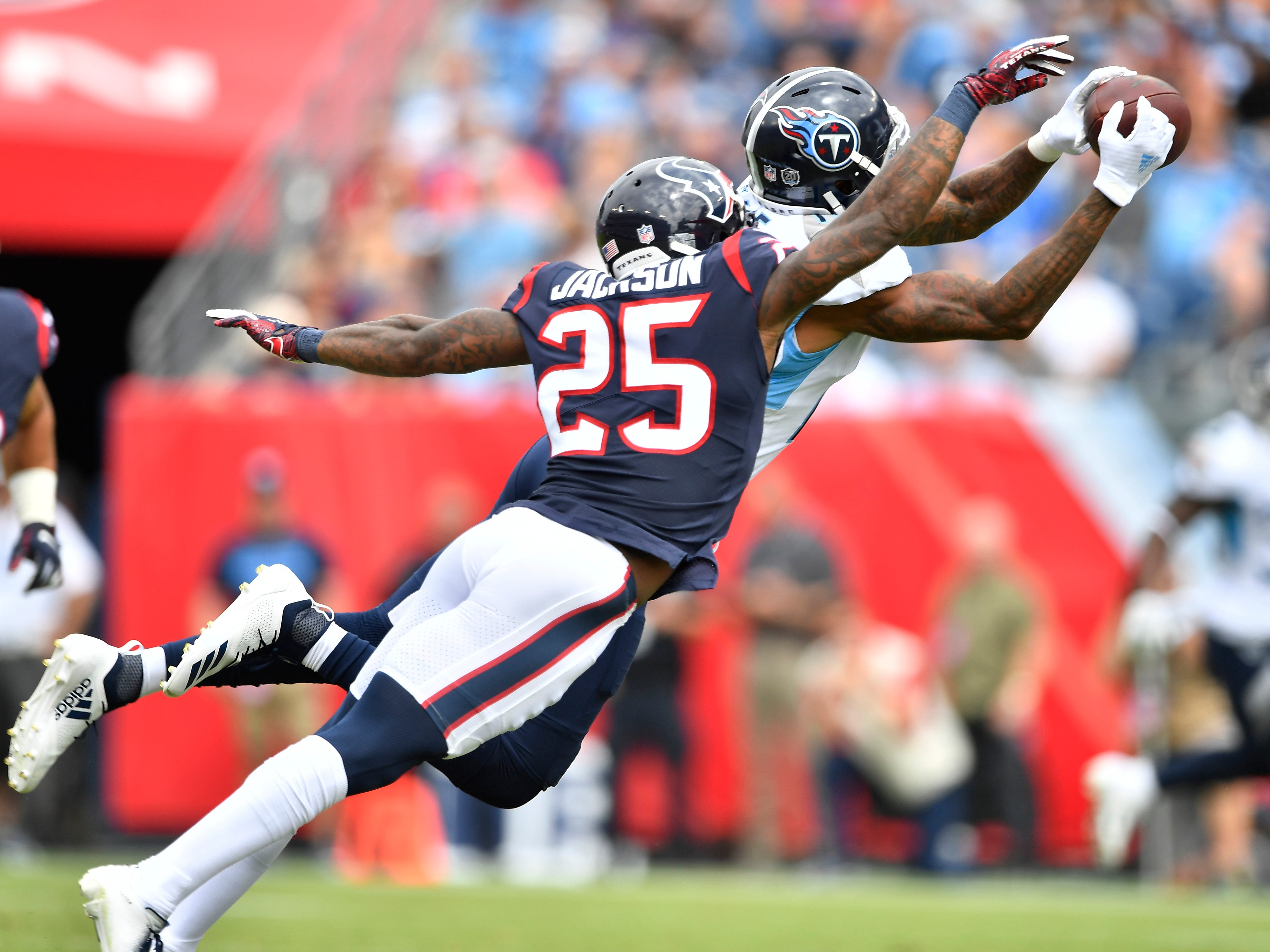 Texans safety Kareem Jackson (25) breaks up a pass intended for Titans wide receiver Tajae Sharpe (19) in the first quarter at Nissan Stadium Sunday, Sept. 16, 2018, in Nashville, Tenn.