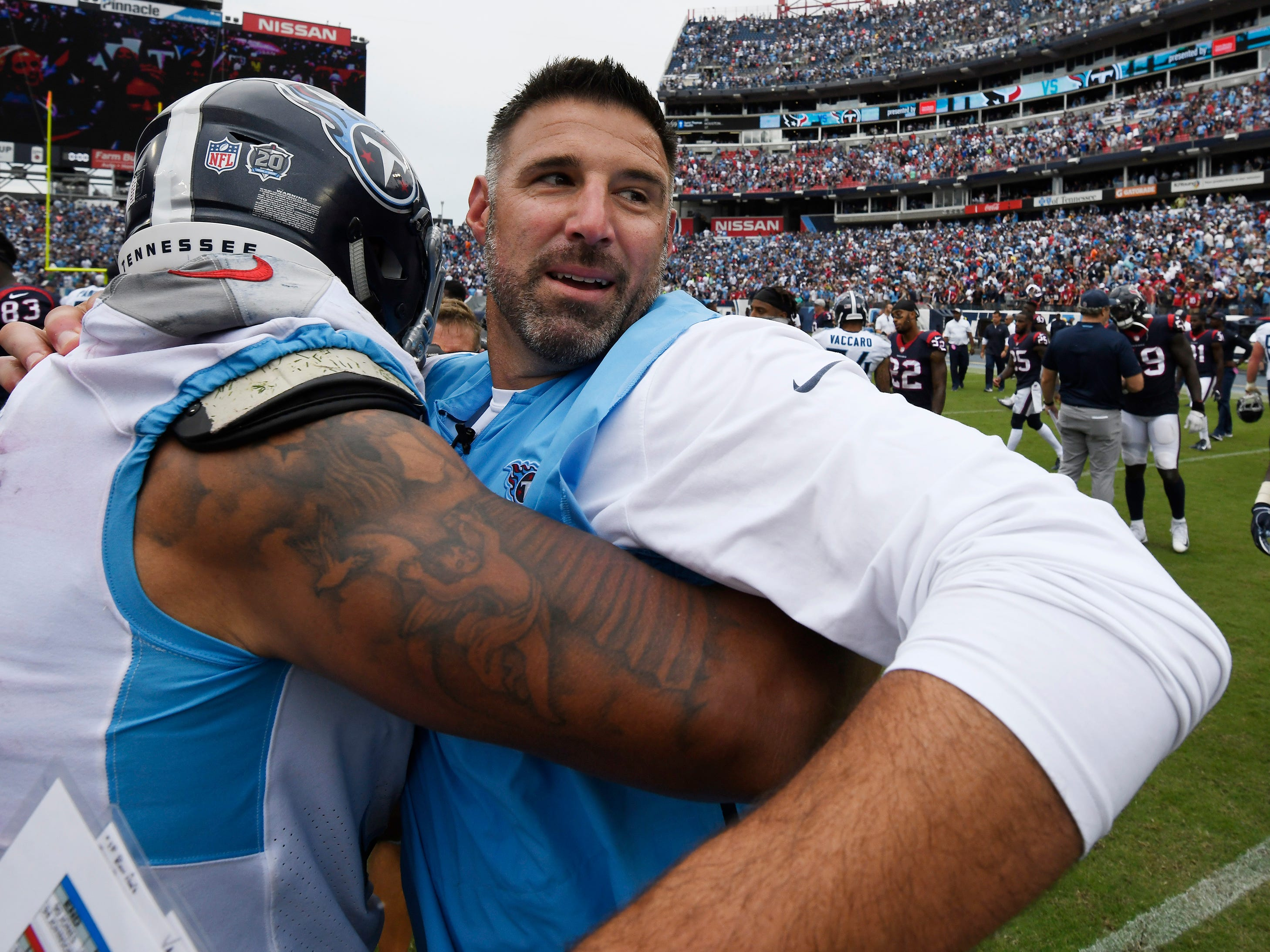 Mike Vrabel hugs linebacker Derrick Morgan (91) after his first win as the Titans head coach at Nissan Stadium Sunday, Sept. 16, 2018, in Nashville, Tenn.