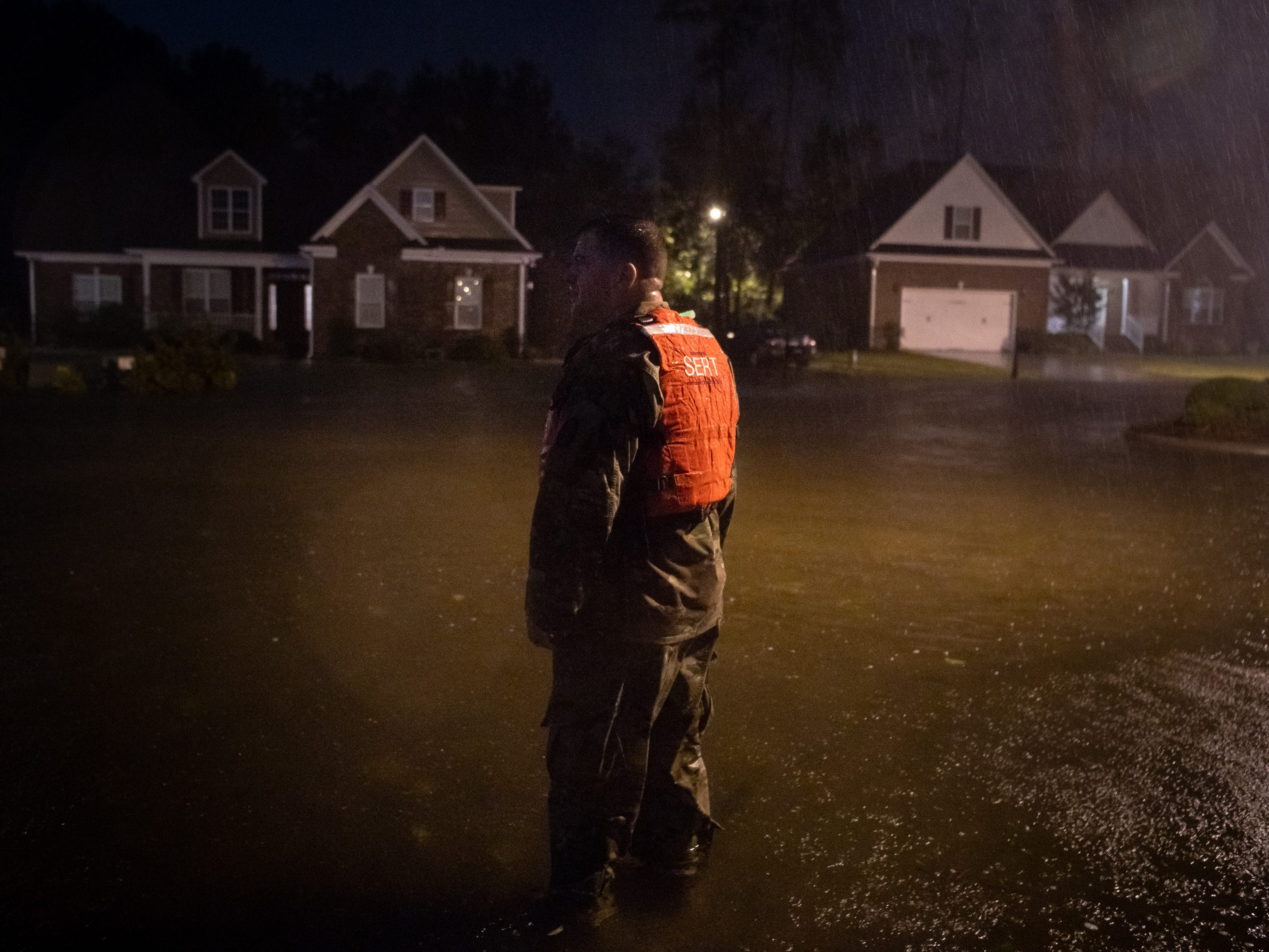 CSM Sid Baker of the North Carolina National Guard patrols a flooded neighborhood as rain from Tropical Storm Florence continues to fall on Lumberton, N.C., Saturday, Sept. 15, 2018.