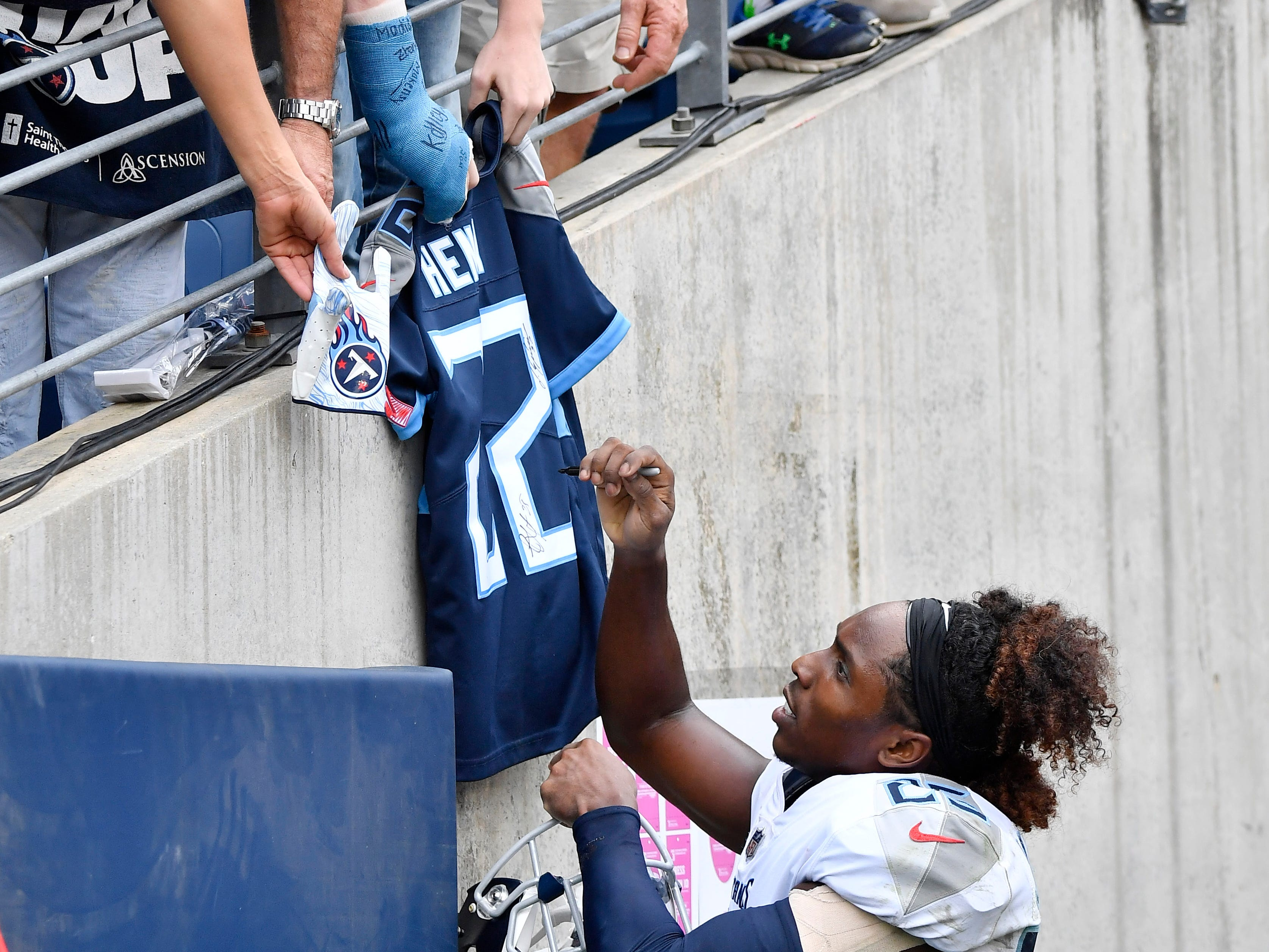 Titans cornerback Adoree' Jackson (25) signs autographs after the team's 20-17 win over the Texans at Nissan Stadium Sunday, Sept. 16, 2018, in Nashville, Tenn.