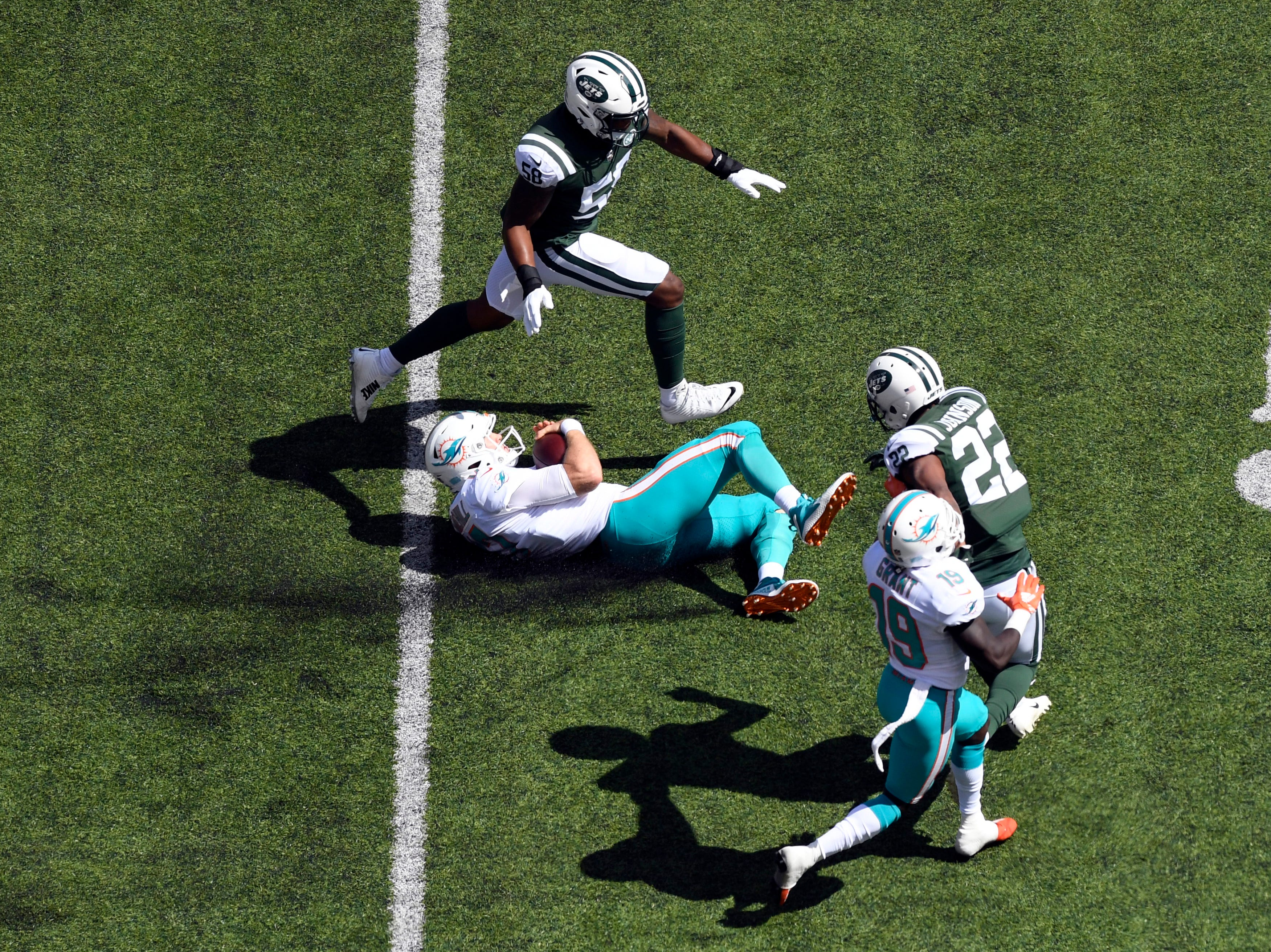 Miami Dolphins quarterback Ryan Tannehill (17) slides for a first down against the New York Jets in Week 2 at MetLife Stadium in East Rutherford, NJ on Sunday, September 16, 2018.