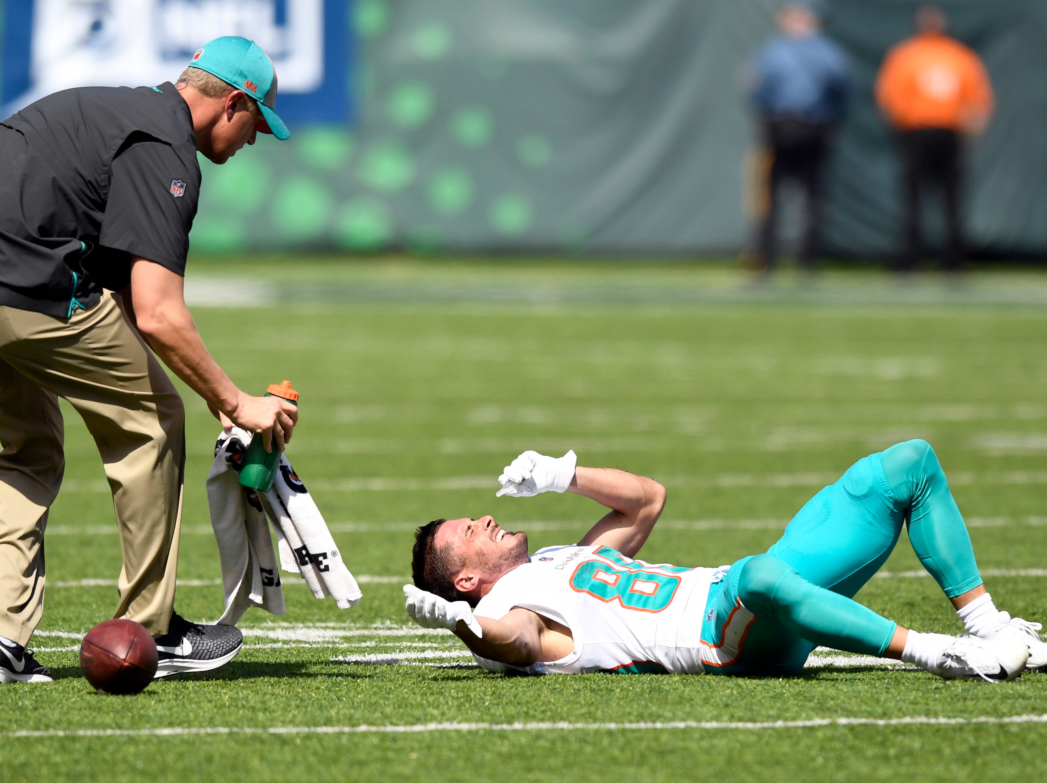 Miami Dolphins wide receiver Danny Amendola (80) grimaces in pain in Week 2 against the New York Jets at MetLife Stadium in East Rutherford, NJ on Sunday, September 16, 2018.