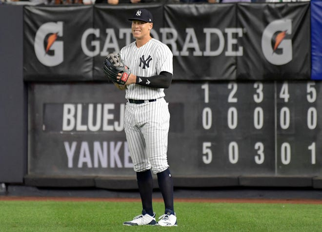 New York Yankees right fielder Aaron Judge smiles after coming into the baseball game in the eighth inning against the Toronto Blue Jays Friday, Sept.14, 2018, at Yankee Stadium in New York.