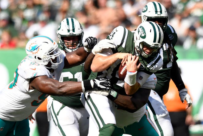 New York Jets quarterback Sam Darnold (14) is sacked by Miami Dolphins defense in Week 2 at MetLife Stadium in East Rutherford, NJ on Sunday, September 16, 2018.