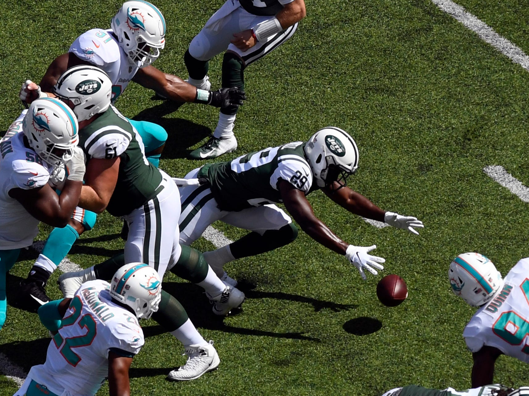 New York Jets running back Bilal Powell (29) fumbles and recovers the ball against the Miami Dolphins in Week 2 at MetLife Stadium in East Rutherford, NJ on Sunday, September 16, 2018.