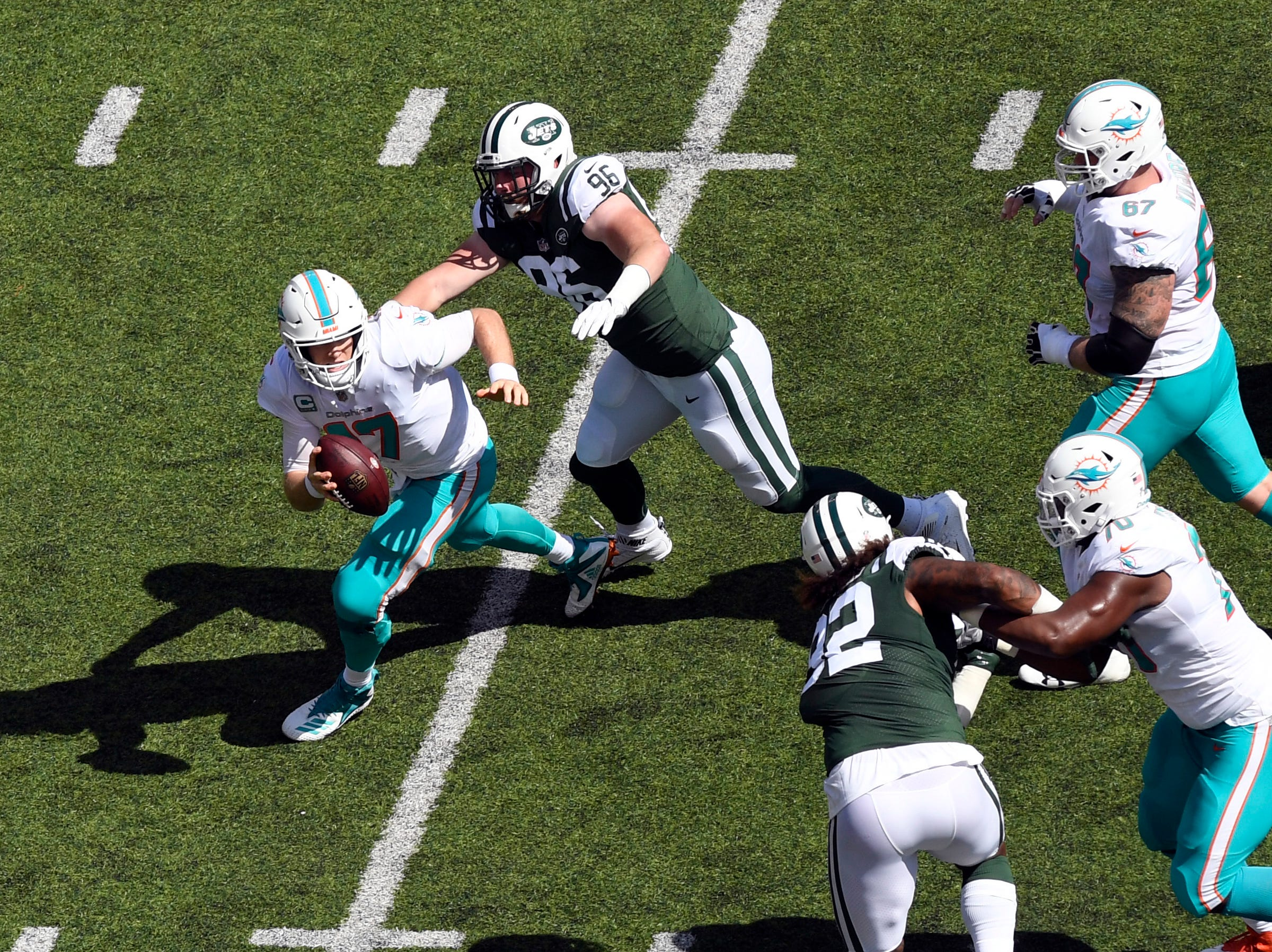 New York Jets defensive end Henry Anderson (96) rushes to sack Miami Dolphins quarterback Ryan Tannehill (17) in Week 2 at MetLife Stadium in East Rutherford, NJ on Sunday, September 16, 2018.
