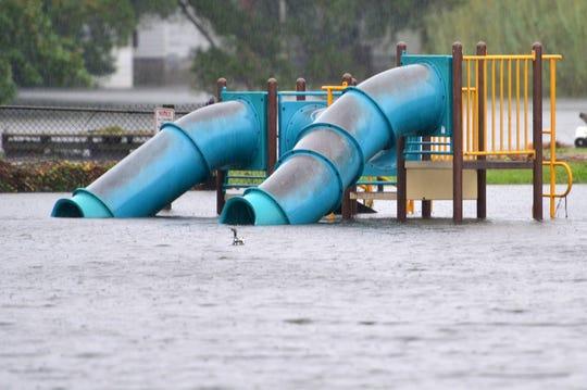Sept 14, 2018; Washington, NC, USA; The rains from Hurricane Florence flooded playground on Willow St..    Mandatory Credit: Tariq Zehari/NorthJersey.com via USA TODAY NETWORK