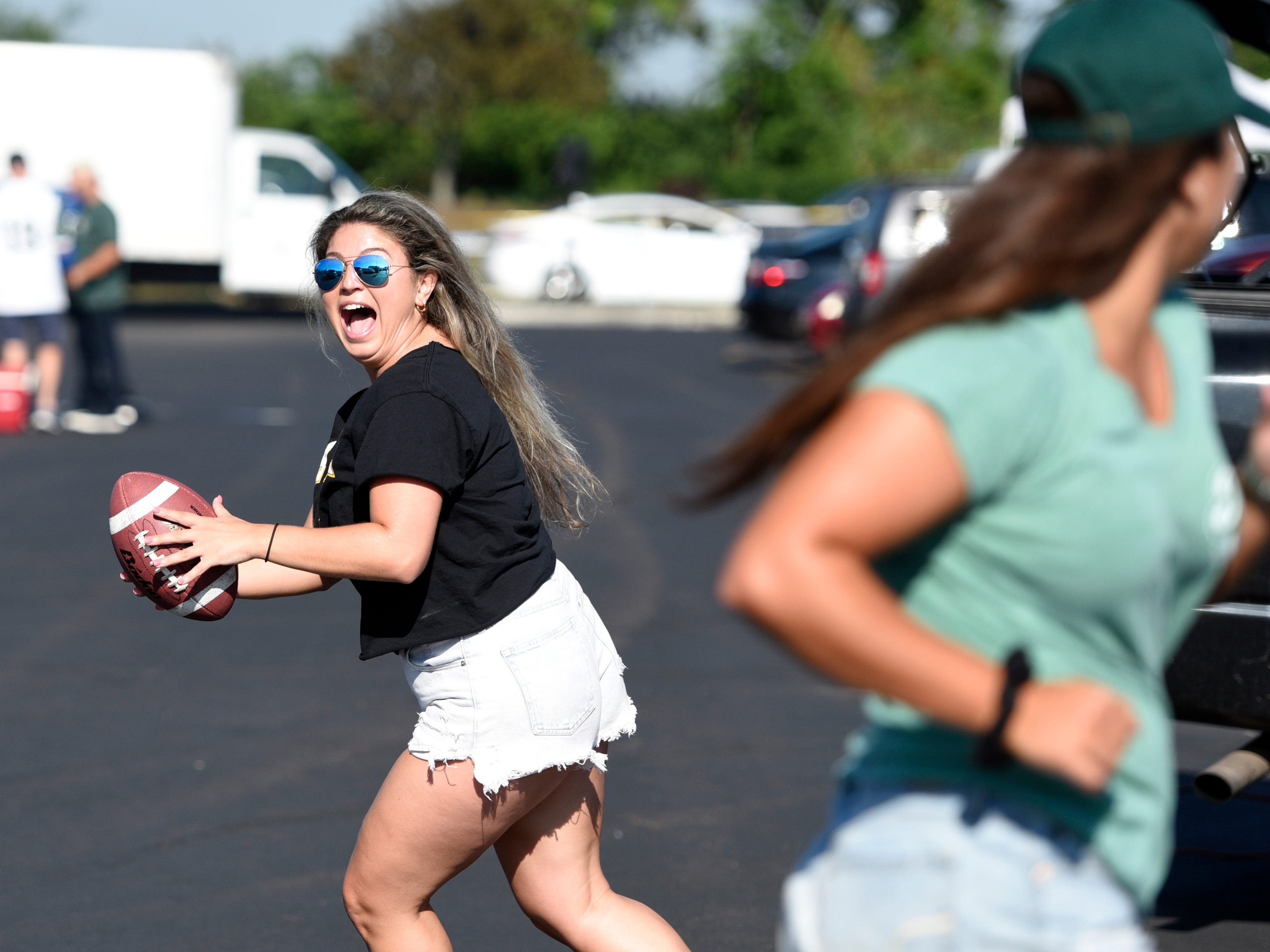 Taylor Boffalo, left, looks to throw to Victoria Vergona, both of Paramus, as they tailgate before the New York Jets face the Miami Dolphins in Week 2 at MetLife Stadium in East Rutherford, NJ on Sunday, September 16, 2018.