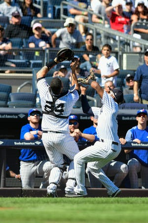 Sep 16, 2018; Bronx, NY, USA; New York Yankees catcher Gary Sanchez (left) and third baseman Miguel Andujar (right) collide on an ball hit by Toronto Blue Jays third baseman Yangervis Solarte (not pictured) in the fourth inning at Yankee Stadium.