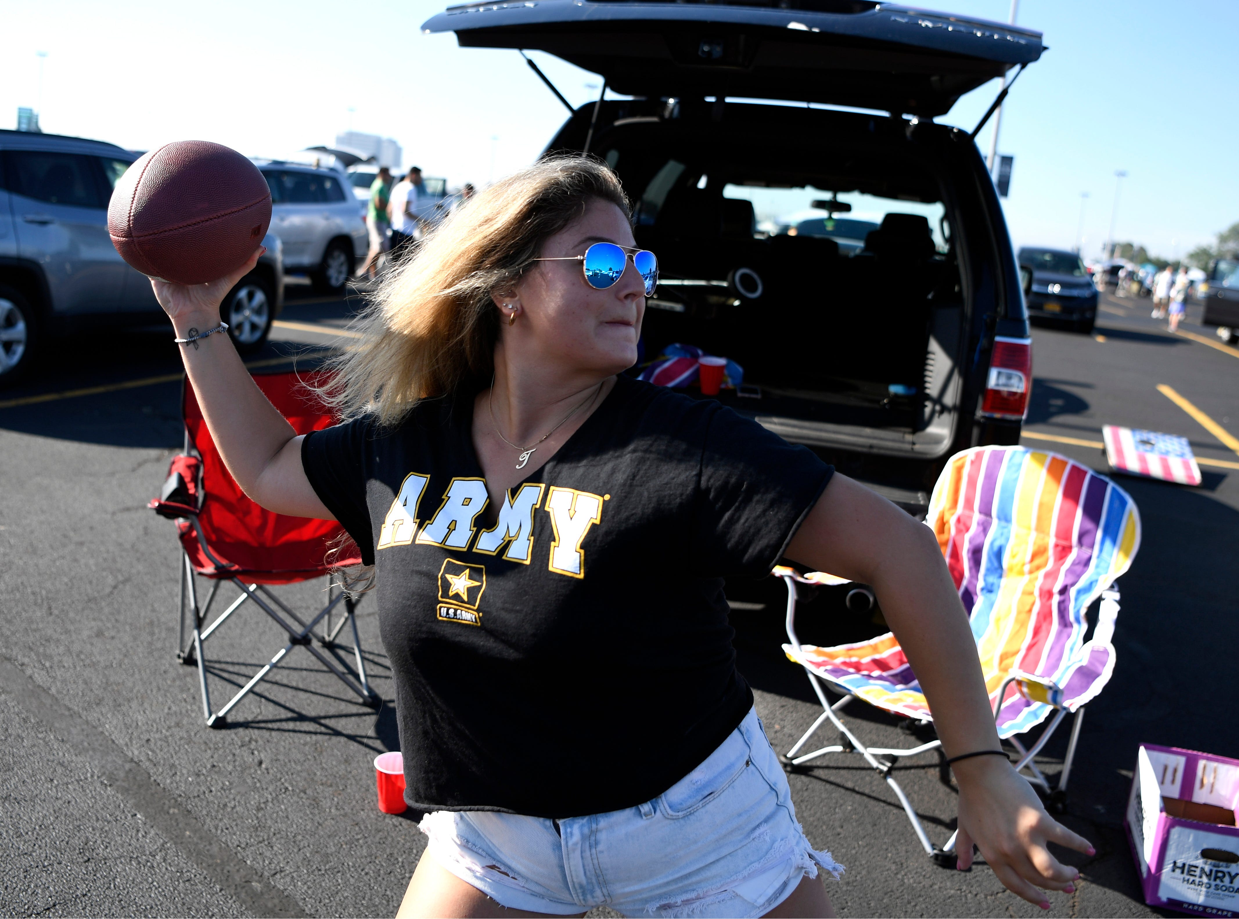 Taylor Boffalo of Paramus throws the football to friends during the tailgate before the New York Jets face the Miami Dolphins in Week 2 at MetLife Stadium in East Rutherford, NJ on Sunday, September 16, 2018.