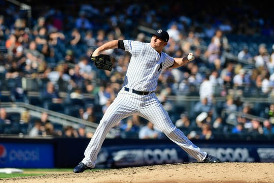 Sep 16, 2018; Bronx, NY, USA; New York Yankees pitcher Zach Britton (53) pitches against the Toronto Blue Jays during the ninth inning at Yankee Stadium.
