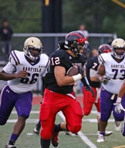 Glen Rock senior LB/RB Seve Bilbao wears the number 12 because his father did.