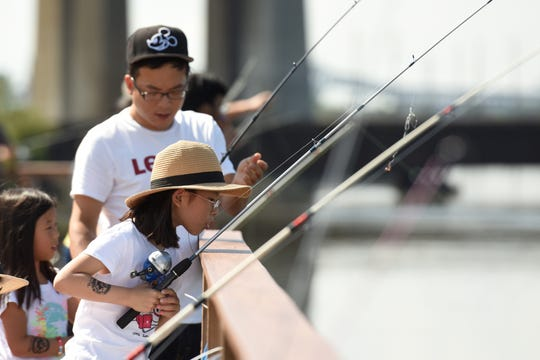 The Hackensack Riverkeeper and the Hudson River Fishermen's Association hosted a free catch and release fishing derby at Laurel Hill Park on Sunday, September 16, 2018. Sia Son 9 of Fort Lee peers is focused on her fishing.