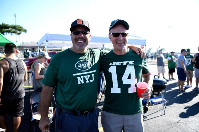 Joe Vergona, left, and Ed Boffalo, both of Paramus, pose for a photo during their tailgate before the New York Jets face the Miami Dolphins in Week 2 at MetLife Stadium in East Rutherford, NJ on Sunday, September 16, 2018.