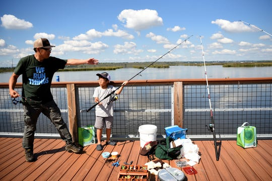 The Hackensack Riverkeeper and the Hudson River Fishermen's Association hosted a free catch and release fishing derby at Laurel Hill Park on Sunday, September 16, 2018. Dong Seo and his son, Daniel Seo 8, fish during the derby.