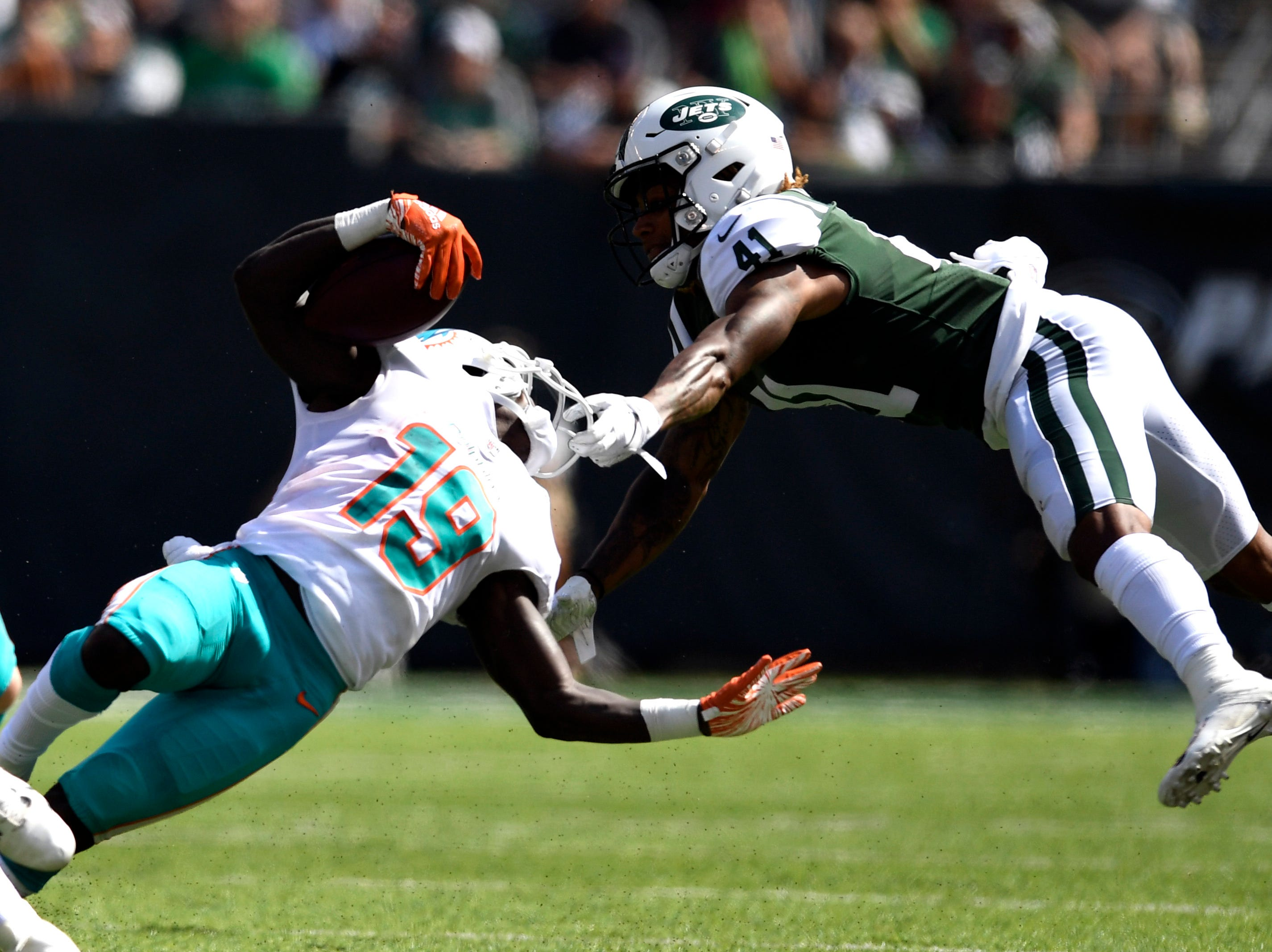New York Jets cornerback Buster Skrine (41) grabs ahold of Miami Dolphins wide receiver Jakeem Grant's (19) face mask in Week 2 at MetLife Stadium in East Rutherford, NJ on Sunday, September 16, 2018.