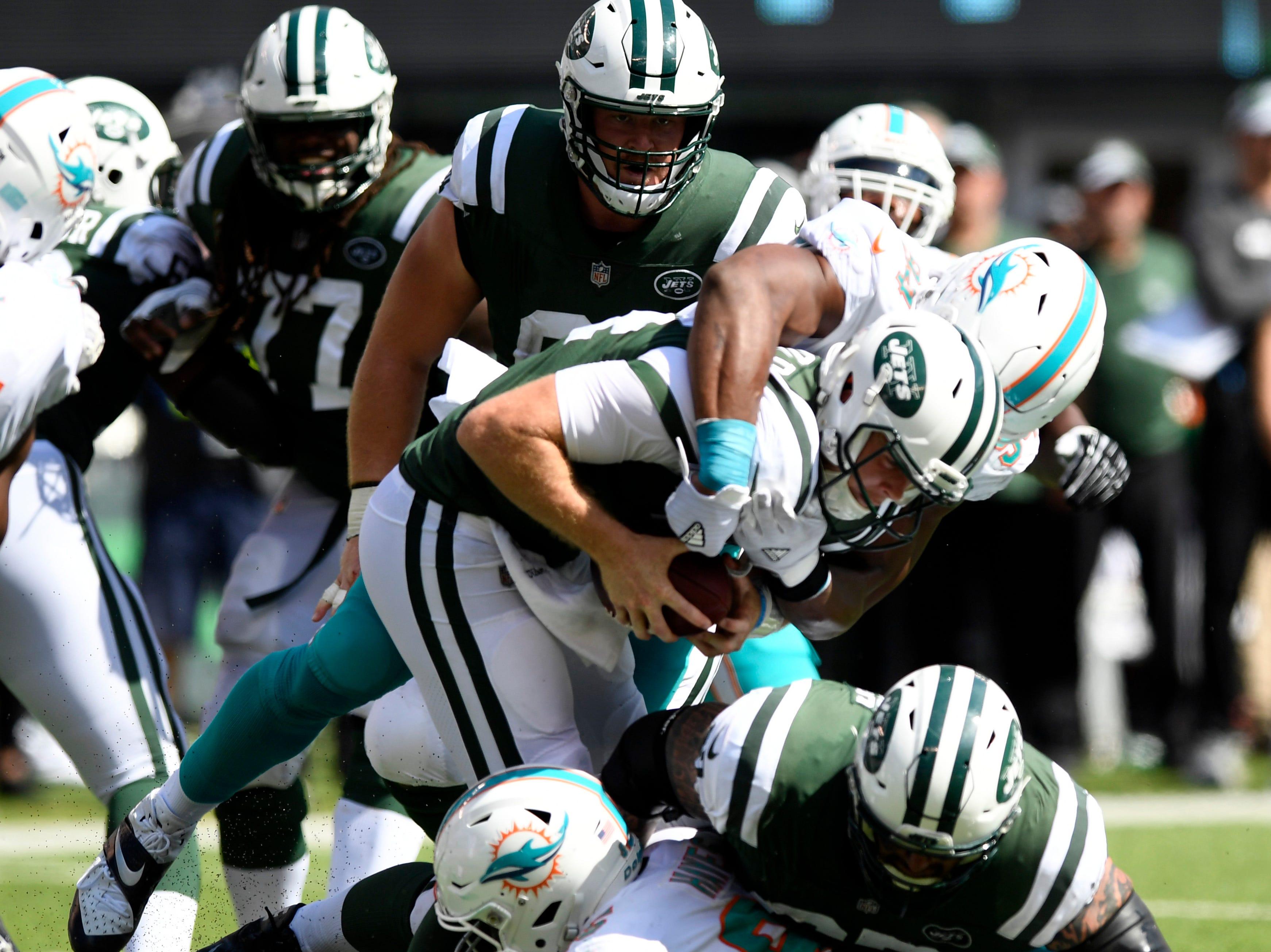 Miami Dolphins defensive end Robert Quinn (94) sacks New York Jets quarterback Sam Darnold (14) in Week 2 at MetLife Stadium in East Rutherford, NJ on Sunday, September 16, 2018.