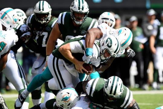 Miami Dolphins defensive end Robert Quinn (94) sacks New York Jets quarterback Sam Darnold (14) in Week 2 at MetLife Stadium in East Rutherford, NJ on Sunday, September 16, 2018.