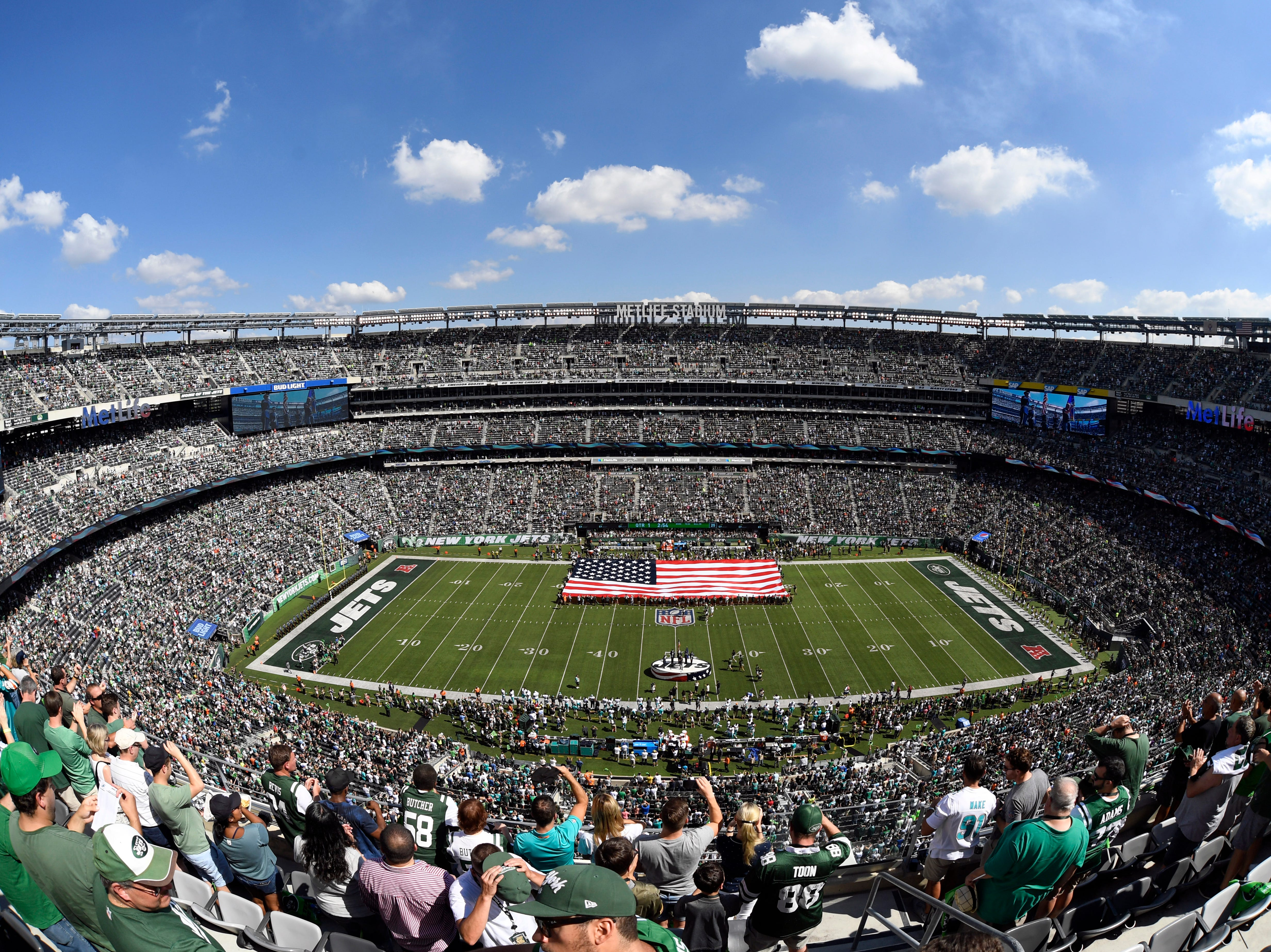 The National Anthem plays ahead of the regular season game between the New York Jets and the Miami Dolphins at MetLife Stadium in East Rutherford, NJ on Sunday, September 16, 2018.