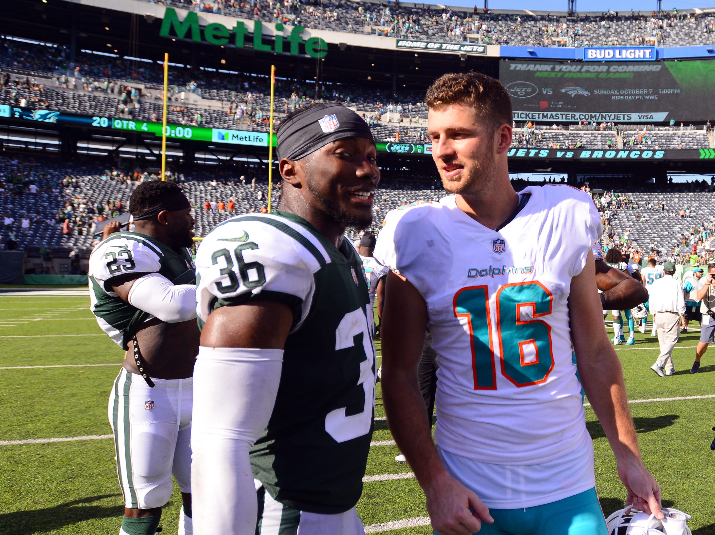 New York Jets safety Doug Middleton (36) and Miami Dolphins wide receiver Tanner McEvoy (16) talk after the Dolphins defeat the Jets, 20-12, in Week 2 at MetLife Stadium in East Rutherford, NJ on Sunday, September 16, 2018. McEvoy is a Hillsdale, NJ native.