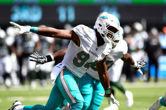 Miami Dolphins defensive end Robert Quinn (94) celebrates sacking New York Jets quarterback Sam Darnold (not pictured) in Week 2 at MetLife Stadium in East Rutherford, NJ on Sunday, September 16, 2018.
