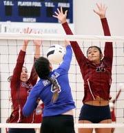 Sophomore Kamryn Zachek and senior Vanessa Garcia teamed on one of 17 Lady 'Cat blocks.