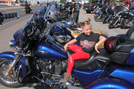 Audrey Dupree, 5, relaxed on a big bike during Saturday's registration at Ramon's Towing on East Pine Street.
