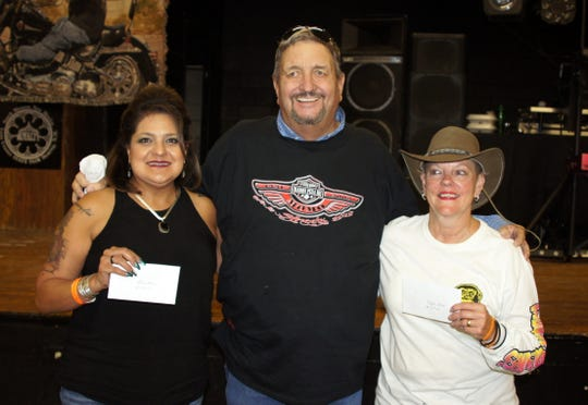 Winners of the high- and low-hand for the bike run were, at left, Linda Herrera, $100 low hand, and Diane Johnson, $250 high hand. Johnson donated $100 back to the RTS Foundation.  Presenting the awards was Jay Spivey.