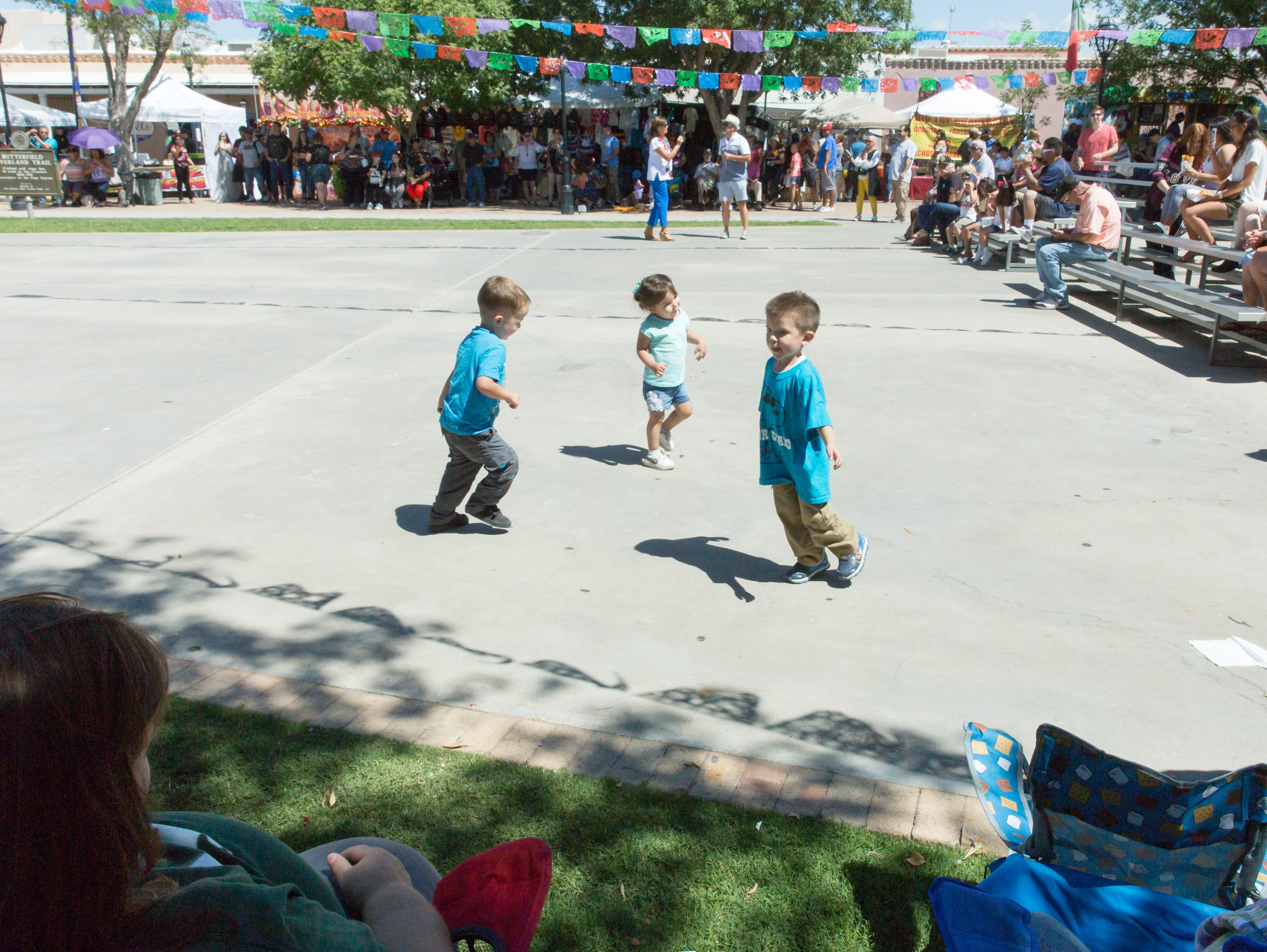 Children dance while Mariachi Tapatio performs in the Mesilla plaza on Sunday, September 16, 2018 during the Diez y Seis de Septiembre Fiesta. The children pictured from left, Alex Hernandez, 4, Yzbella Hernandez, 2, and Roberto Lucero.
