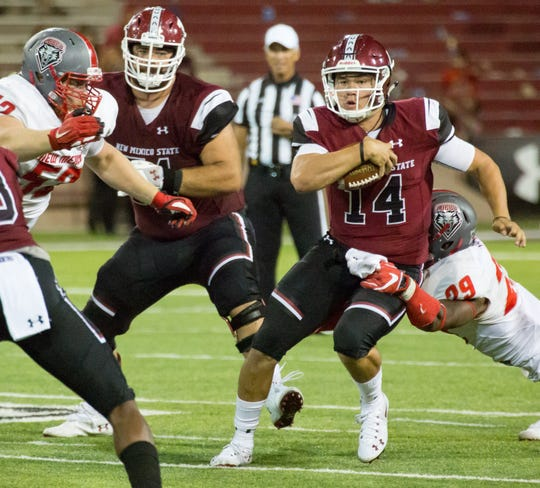 NMSU Josh Adkins runs for yards on Saturday, September 15, 2018 at Aggie Memorial Stadium against UNM.