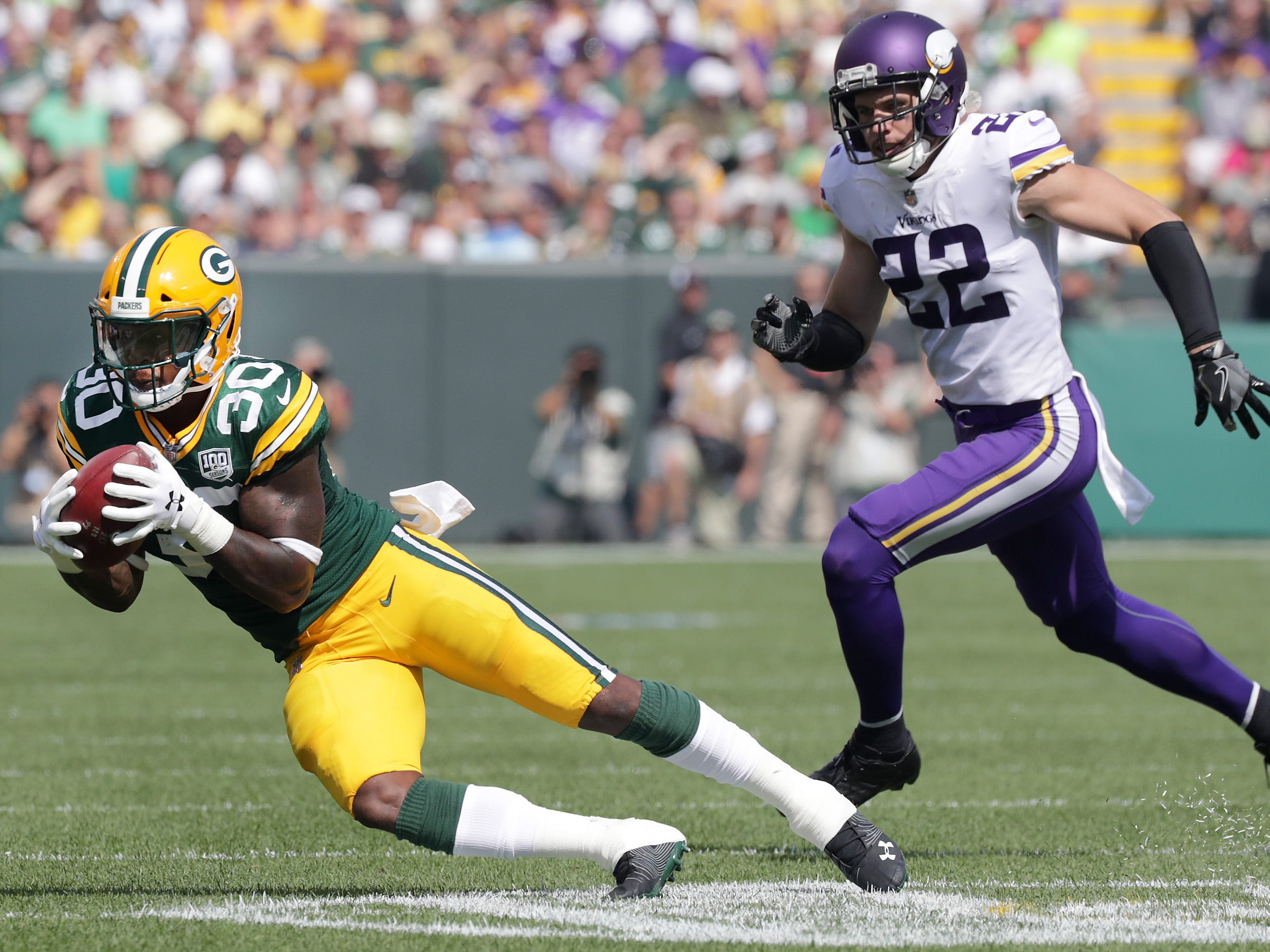 Green Bay Packers' Jamaal Williams catches a pass in the flats in front of the defense of Minnesota Vikings' Harrison Smith during their football game on Sunday, September 16, 2018, at Lambeau Field in Green Bay, Wis.