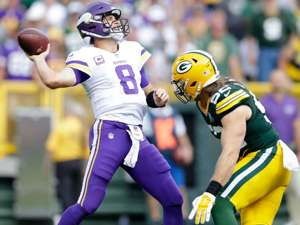 Green Bay Packers linebacker Clay Matthews (52) hits Minnesota Vikings quarterback Kirk Cousins (8) in the fourth quarter against the Minnesota Vikings at Lambeau Field on Sunday, September 16, 2018 in Green Bay, Wis.