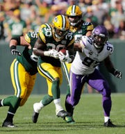 Green Bay Packers running back Jamaal Williams (30) carries the ball late in game against the Minnesota Vikings during their football game Sunday, Sept. 16, 2018, at Lambeau Field in Green Bay, Wis.