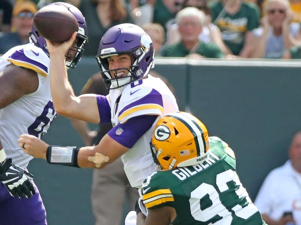 Green Bay Packers linebacker Reggie Gilbert (93) pressures quarterback Kirk Cousins (8) against the Minnesota Vikings Sunday, September 16, 2018 at Lambeau Field in Green Bay, WIs.