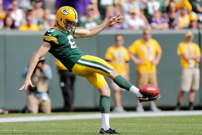 Green Bay Packers punter JK Scott (6) kicks from his end zone in the first half at Lambeau Field on Sunday, September 16, 2018 in Green Bay, Wis.